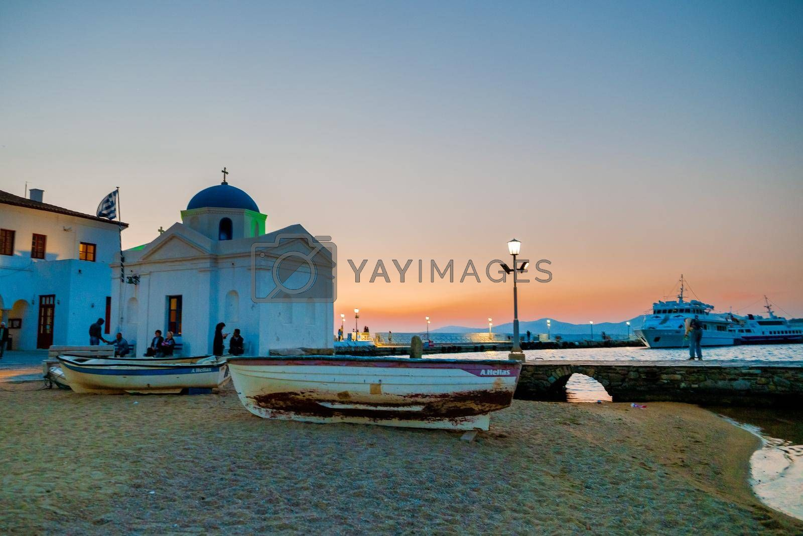 Mykonos Greece April 2018, colorful streets of the old town of Mykonos with tourists in the street. , Traditional narrow street with blue doors and white walls, shopping street, Mykonos town Greece