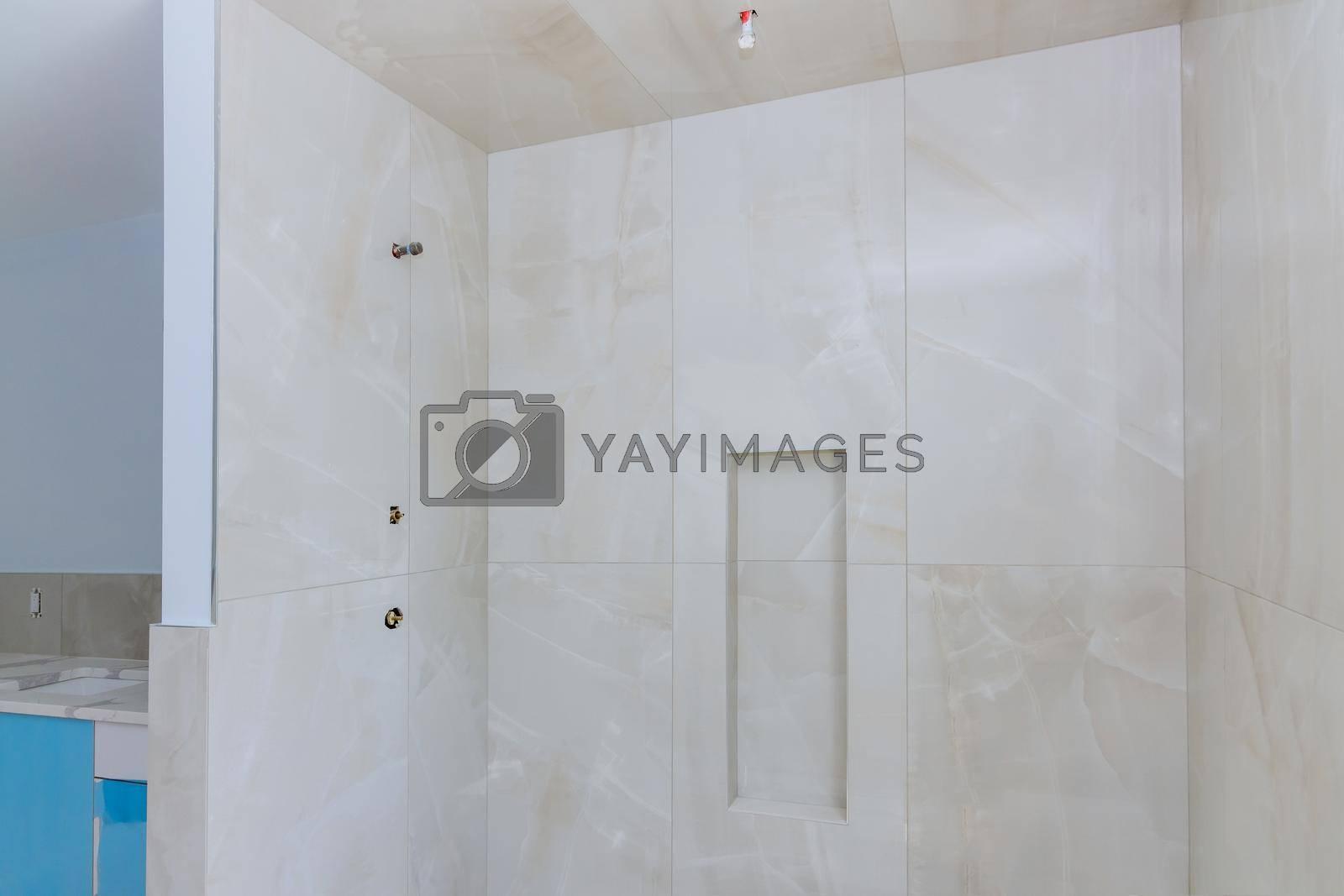 Royalty free image of Designer renovation construction bathroom with master bathroom walls tiled shower by ungvar