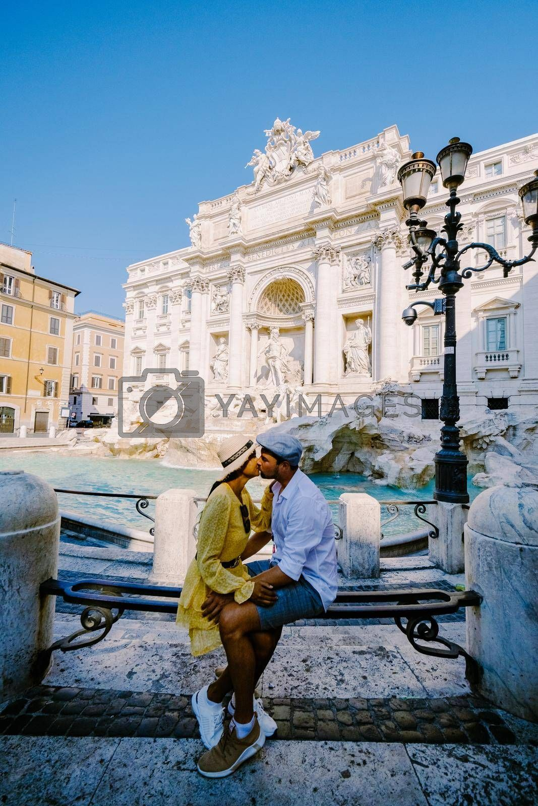 Trevi Fountain, Rome, Italy. City trip couple on a city trip in Rome, view of Di Trevi fountain. Asian woman and European man on a city trip in Rome