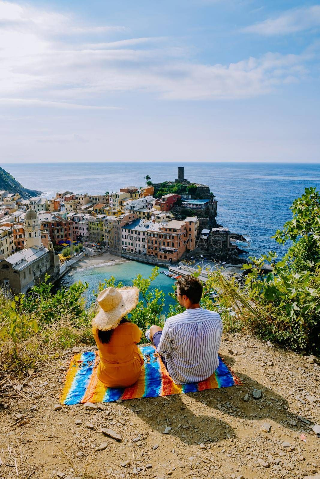 Cinque Terre, Italy, The picturesque coastal village of Vernazza, Cinque Terre, Italy, couple man, and woman European men and Asian woman watching the sunset at Vernazza Cinque Terre Italy