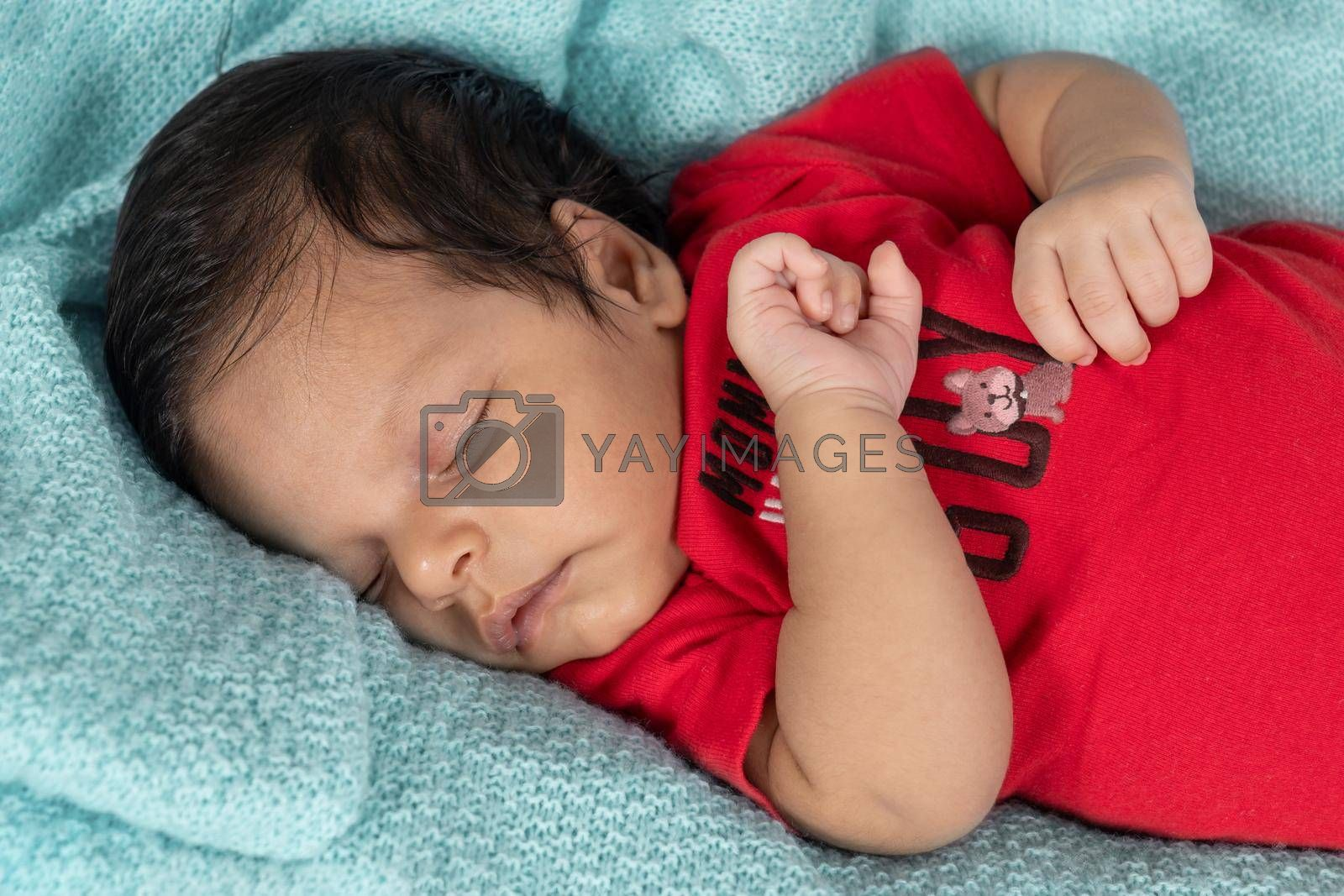 Royalty free image of Infant lying on his back by jrivalta