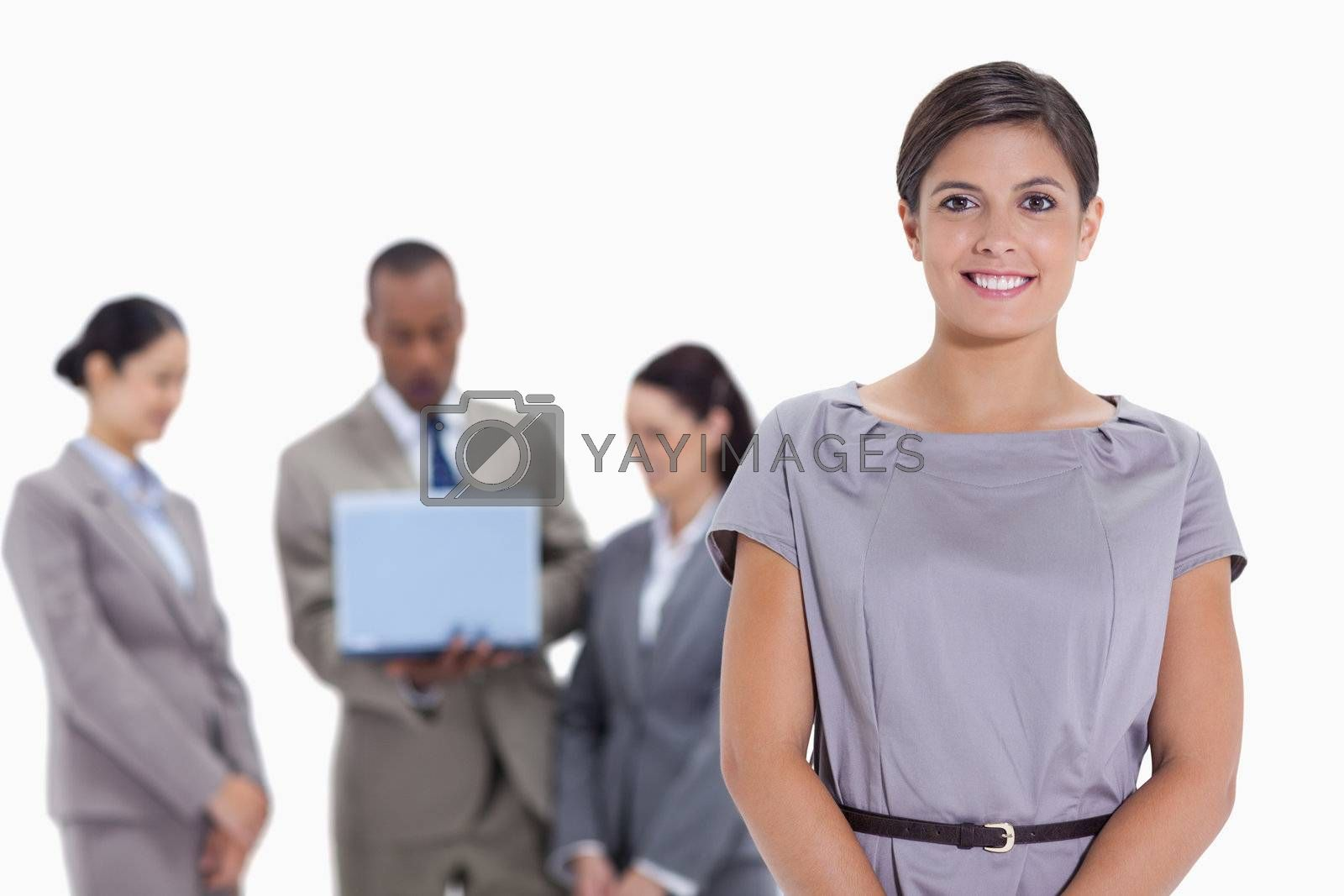 Woman business team in the background watching a laptop against white background