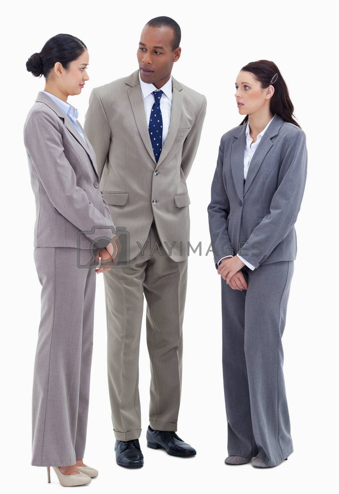 Two business people watching their copworker against white background