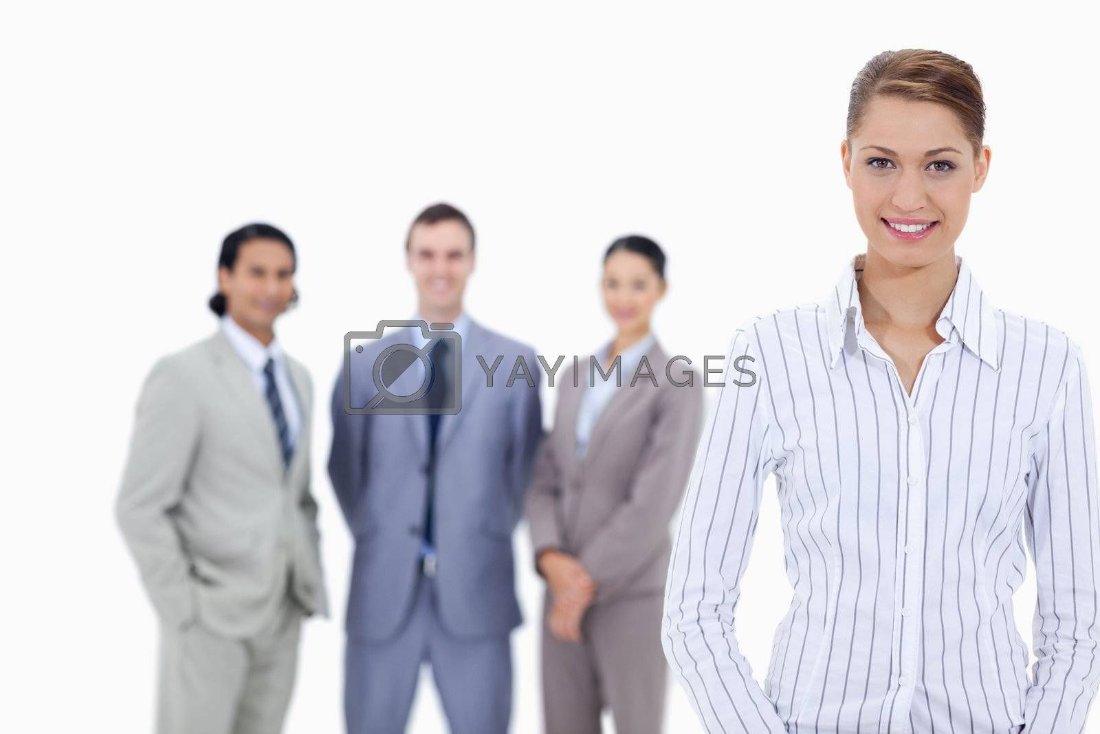 Secretary smiling with happy business people in background