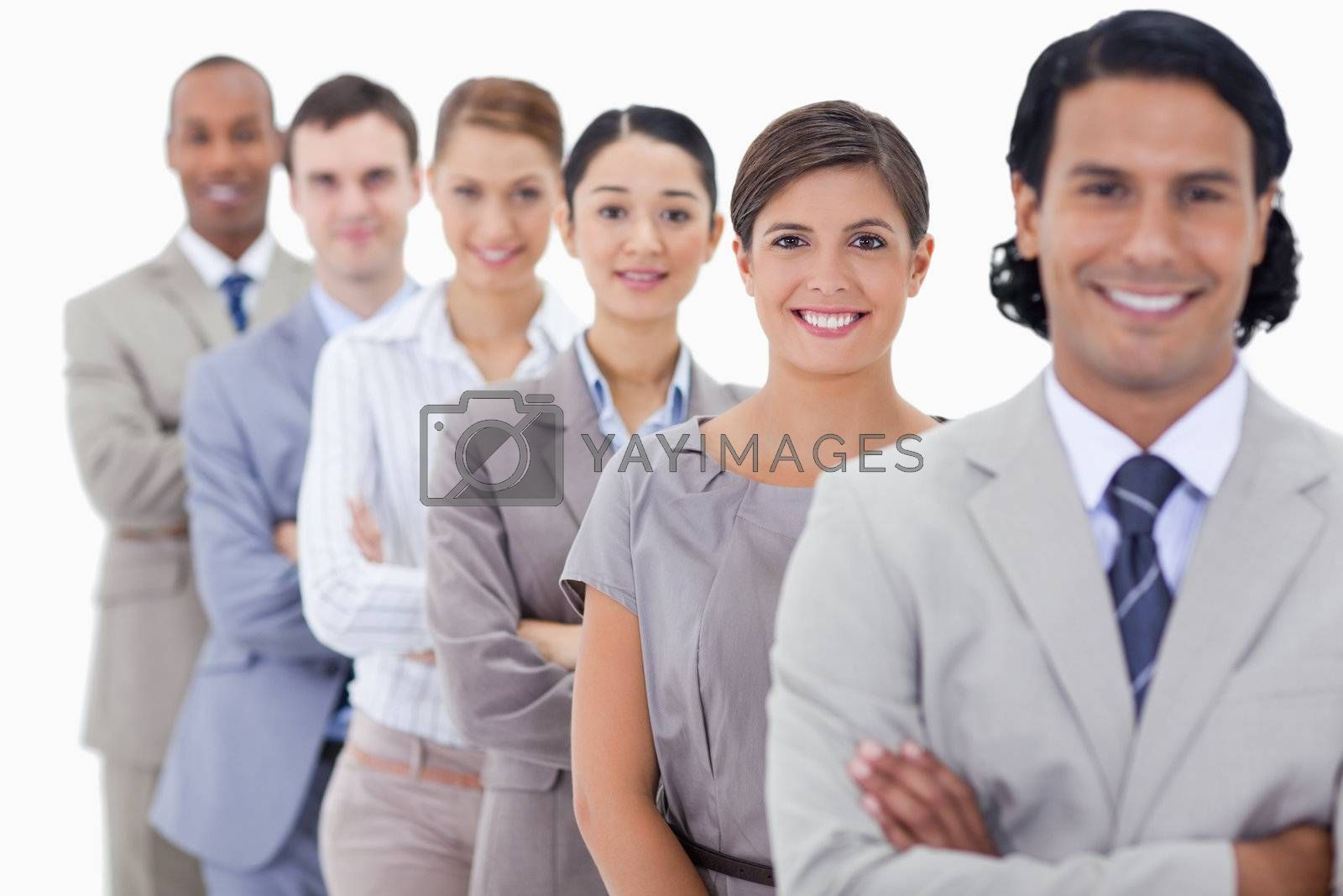Big close-up of happy colleagues in a single line with focus on the first woman