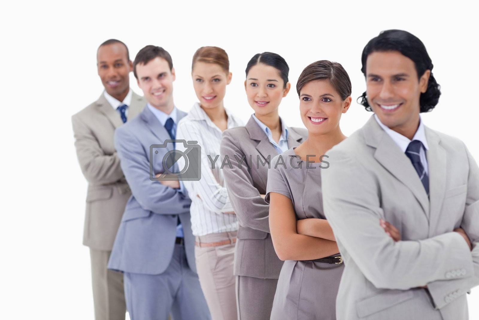 Close-up of a business team smiling in a single line looking towards the left side with focus on the first woman