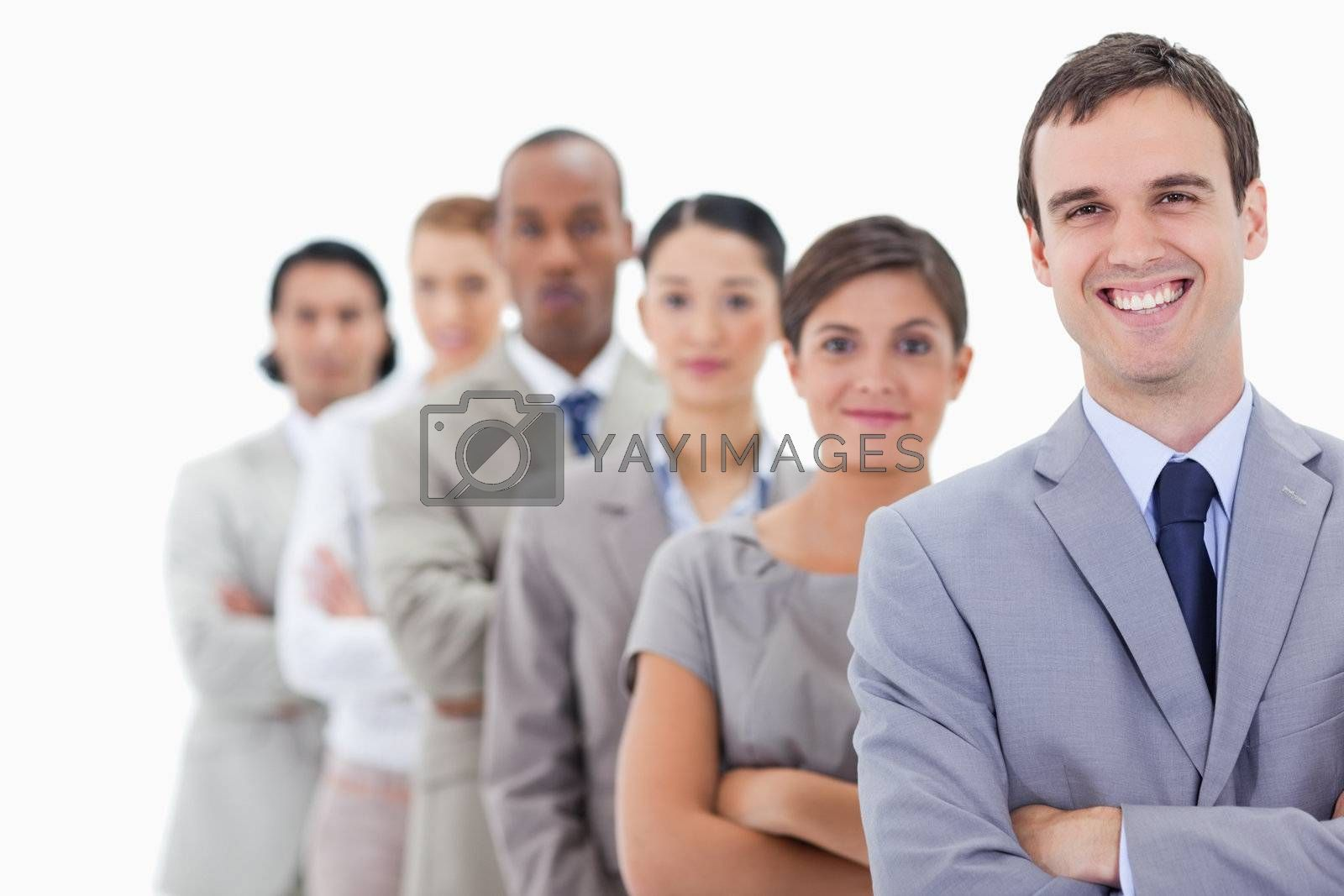 Big close-up of colleagues in a single line looking straight with focus on the first man laughing