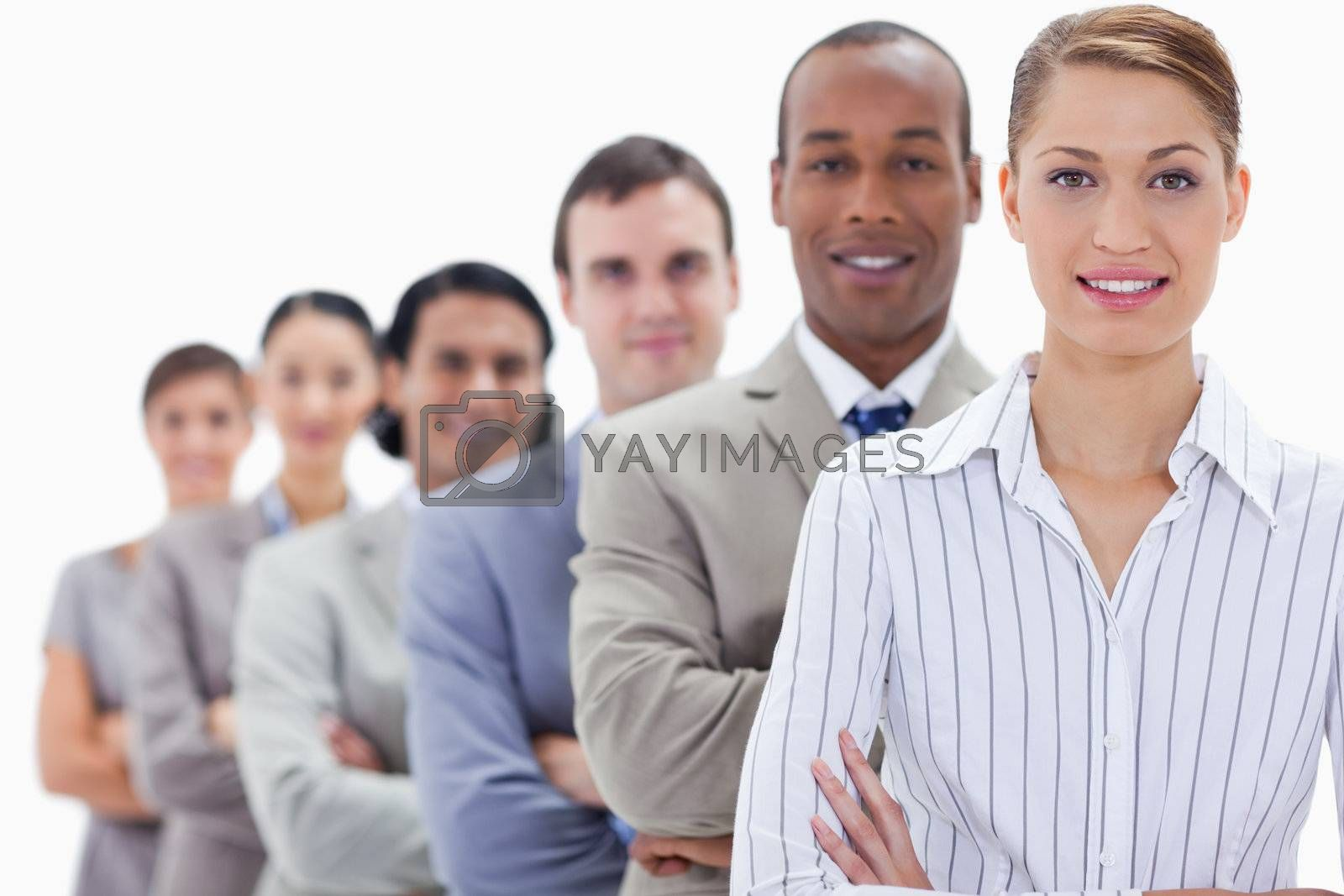 Close-up of a business team crossing their arms in a single line with focus on the first two people
