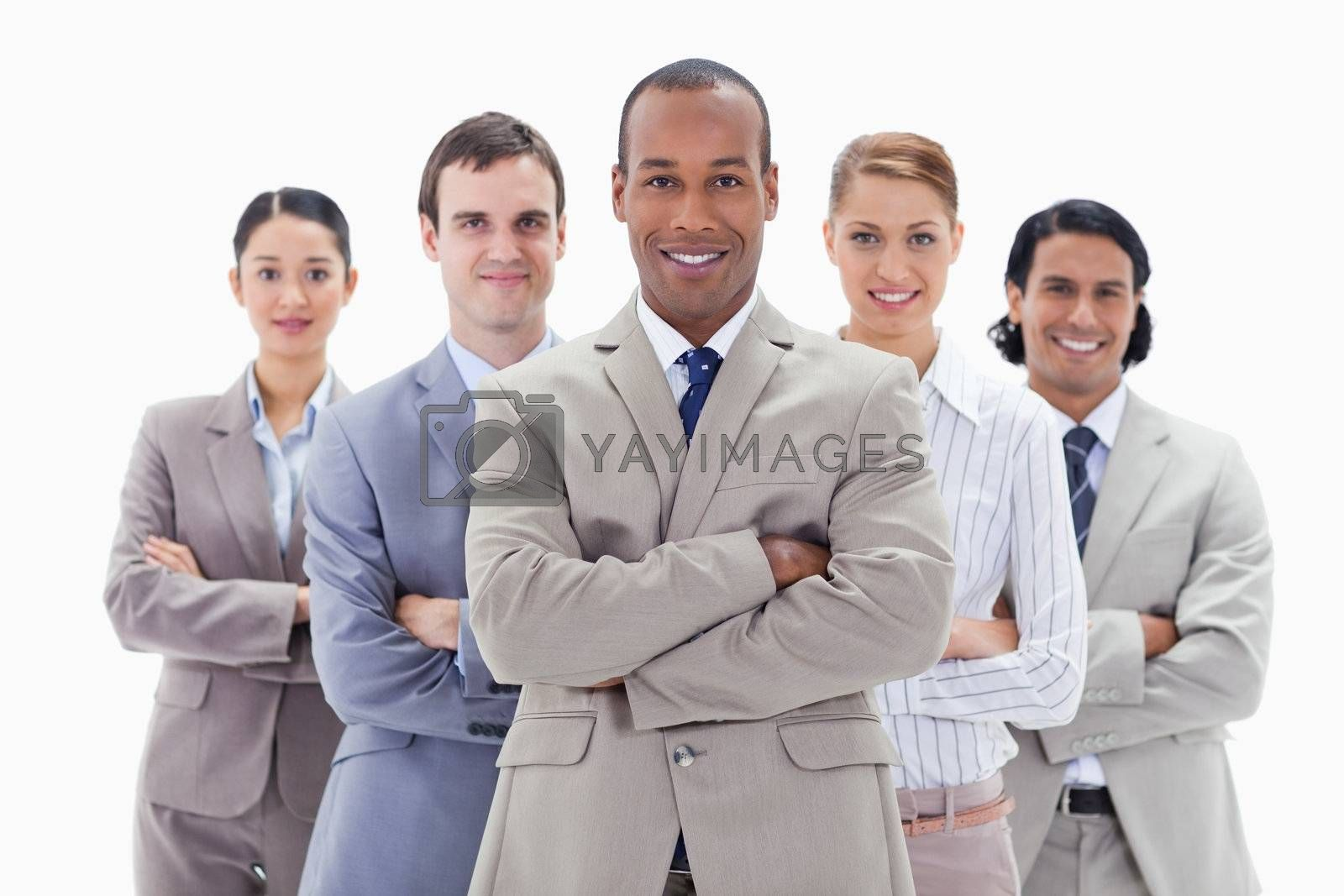 Close-up of a business team smiling and crossing their arms against white background