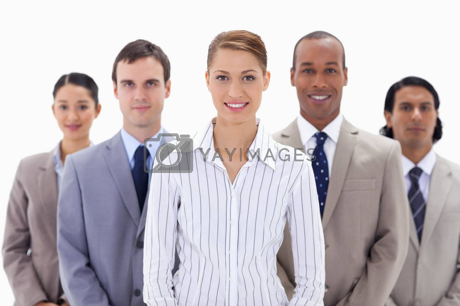 Close-up of a business team a smiling with focus on the woman in the center