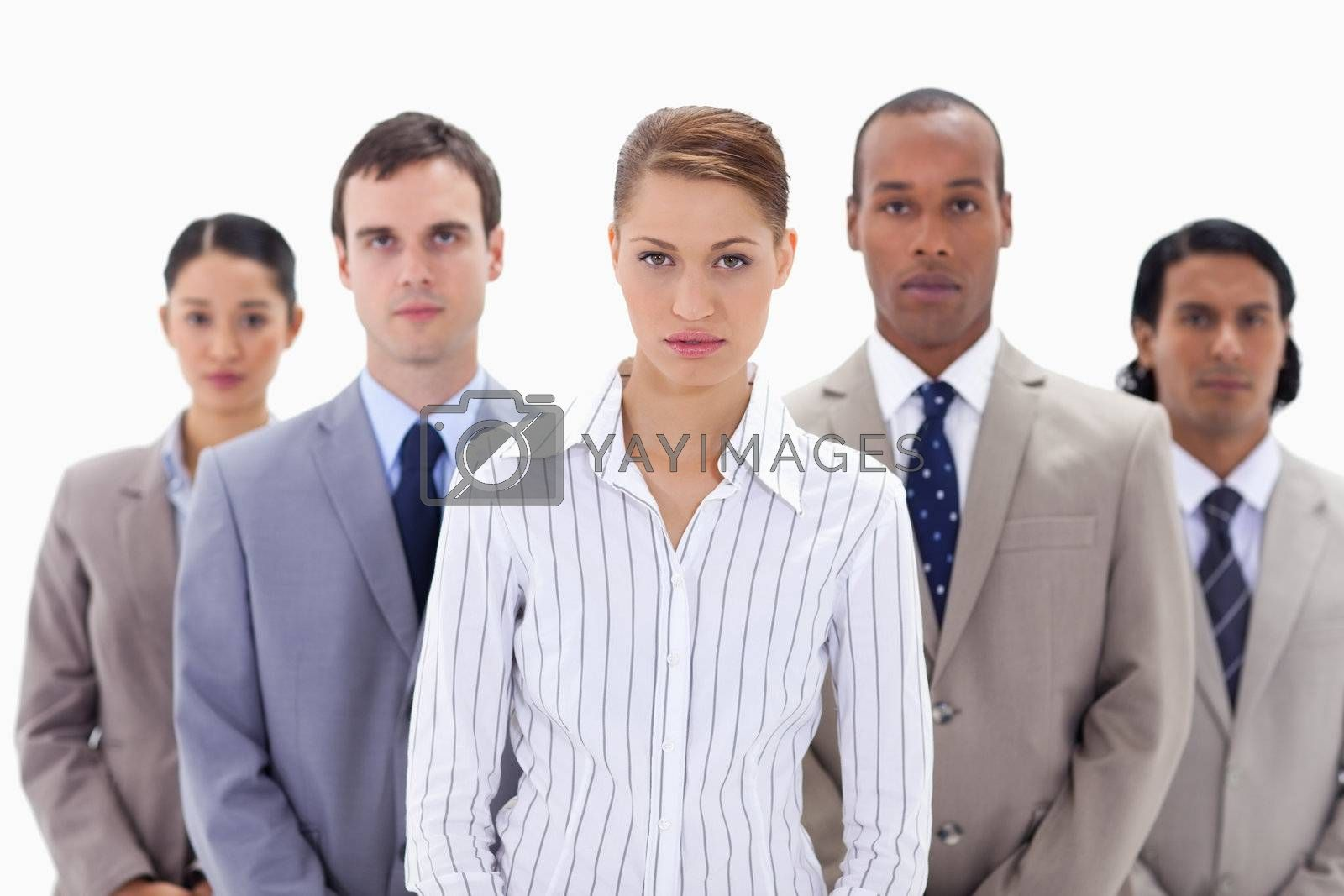 Close-up of a serious business team with focus on the woman in the center