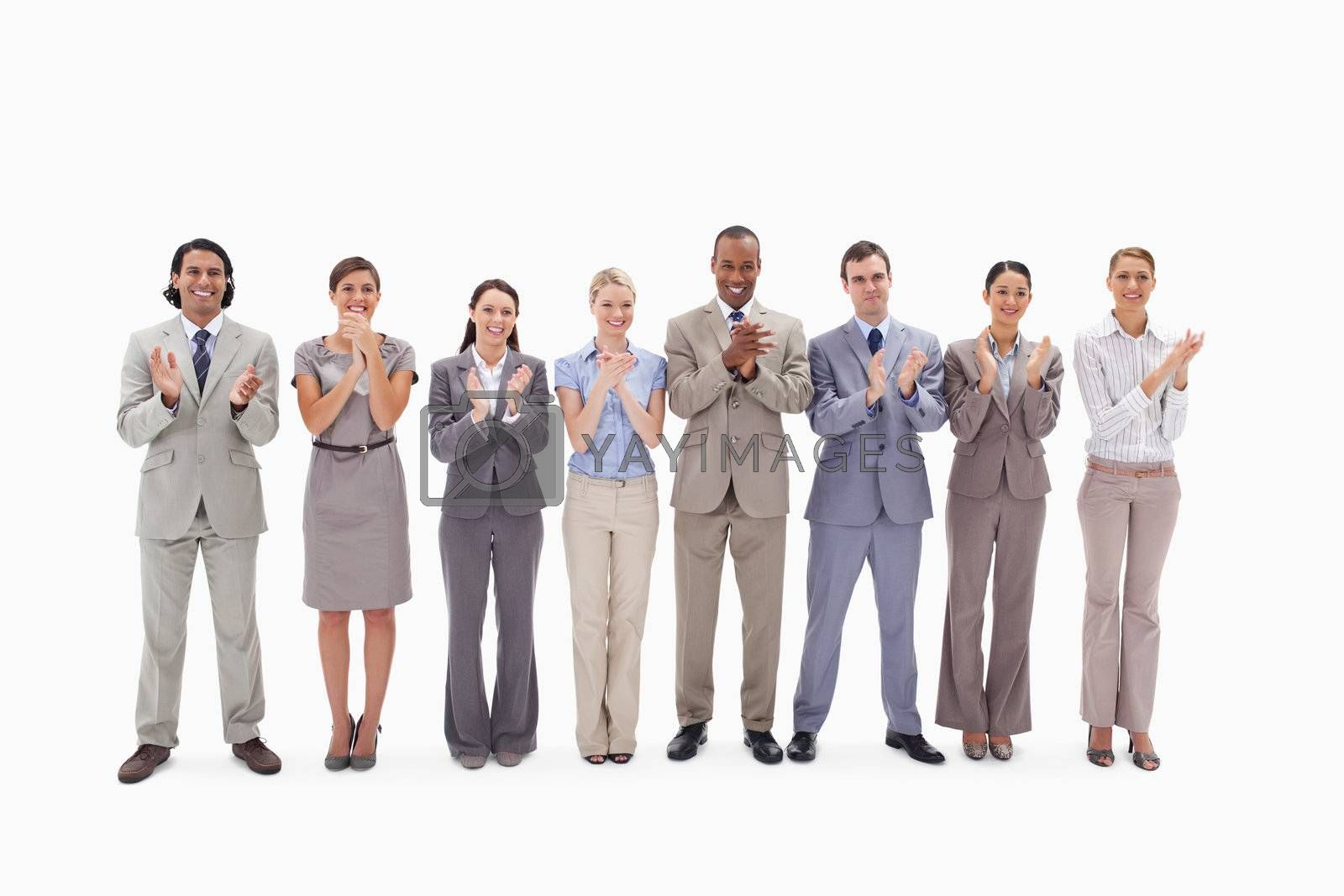 Business team applauding against white background