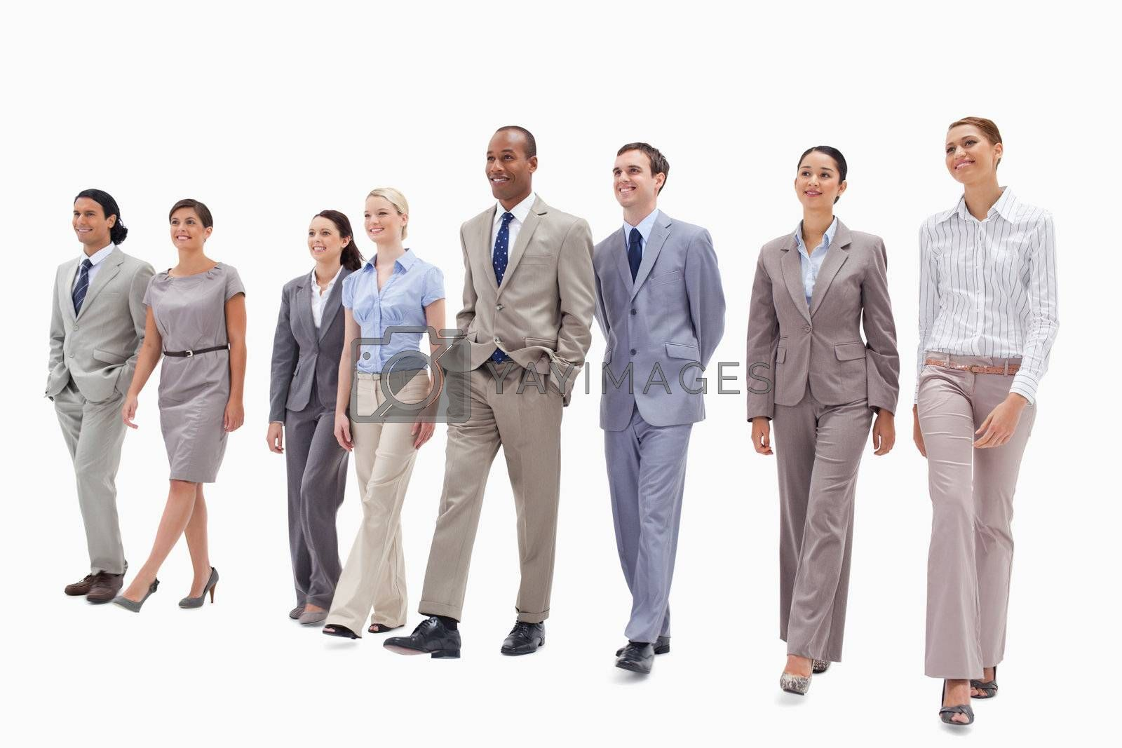 Happy business team walking against white background