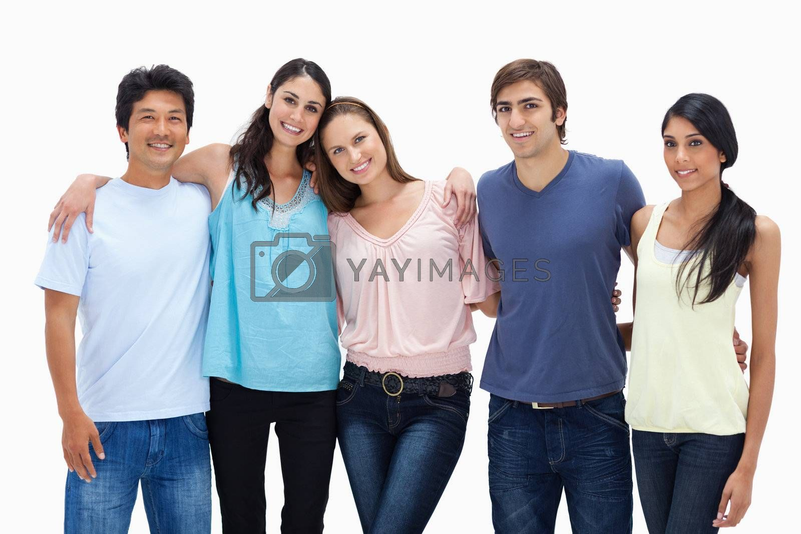Friends arm in arm against white background