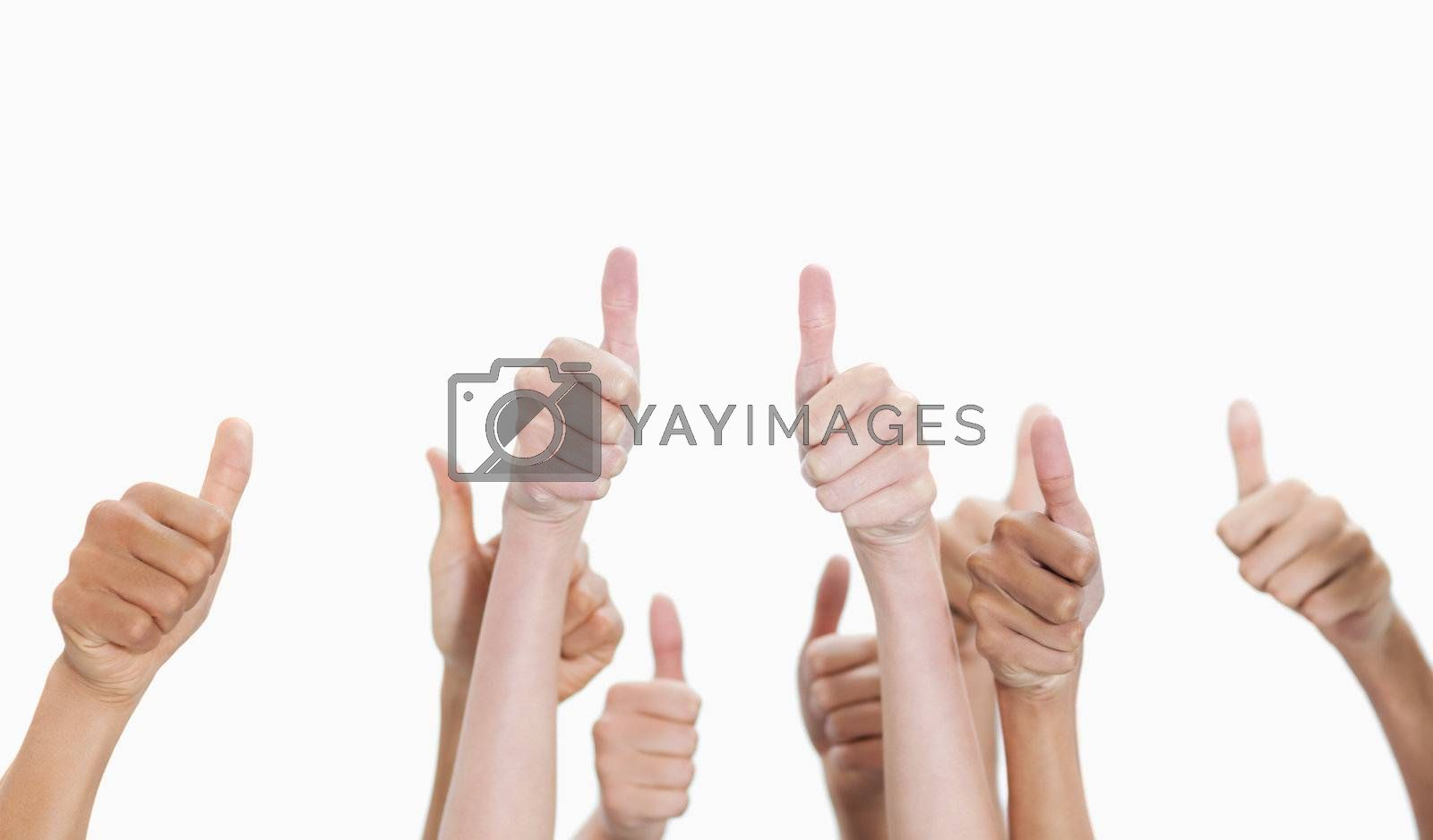 Thumbs-up against white background