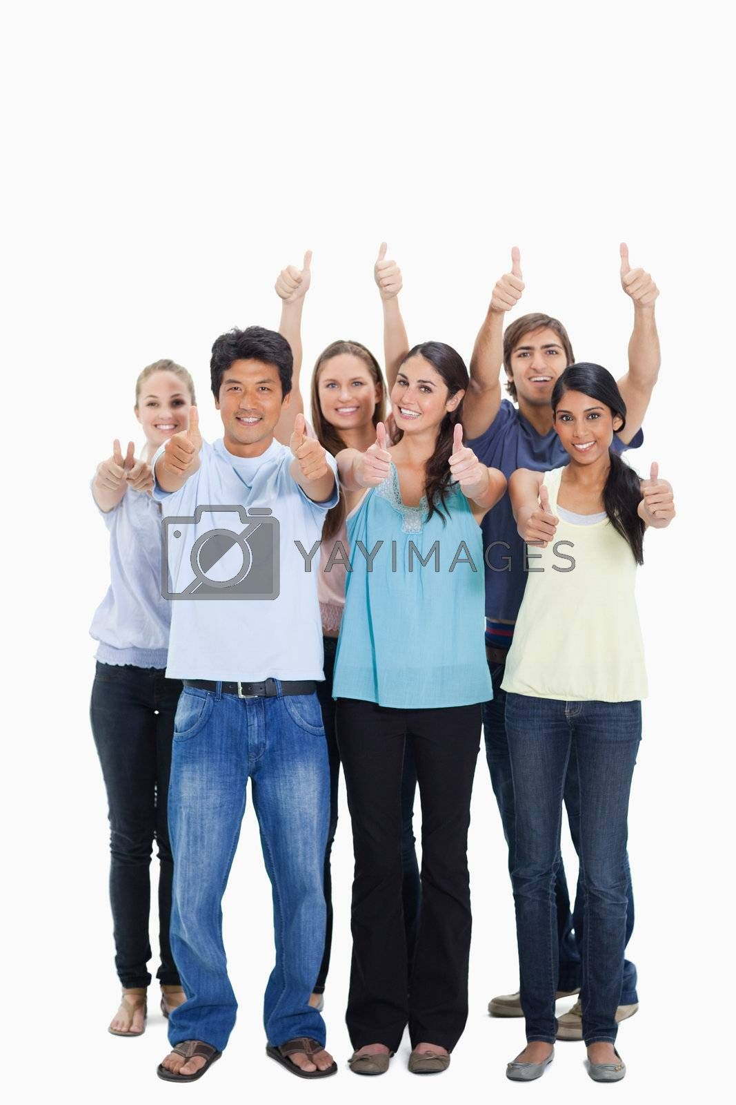 People smiling together and approving with the thumbs-up against white background