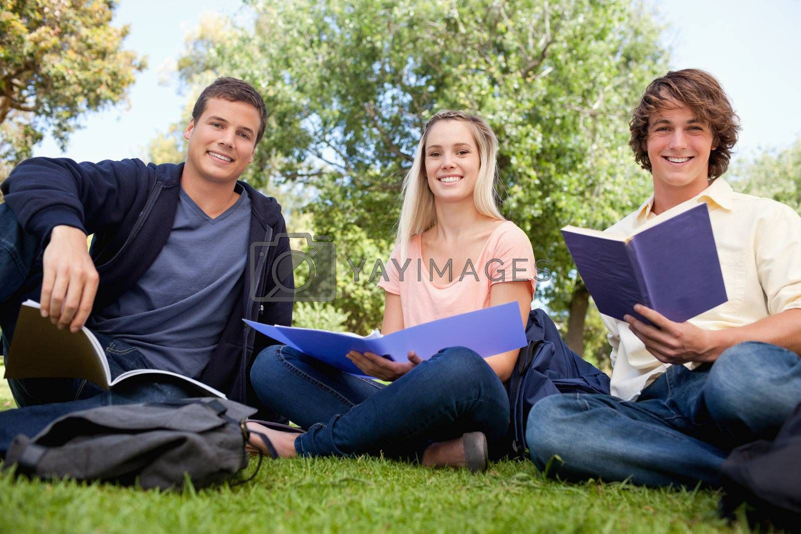 Low angle-shot of three smiling students working