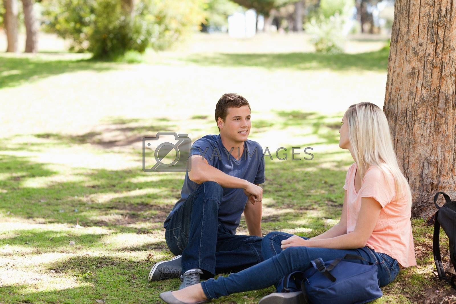 Young people flirting in a park