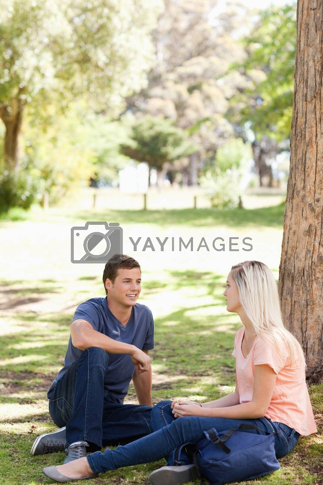 Students flirting in a park