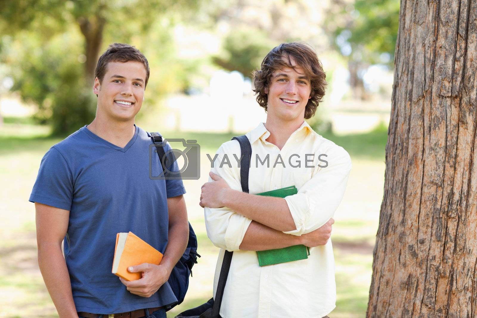 Close-up of two standing male students in a park