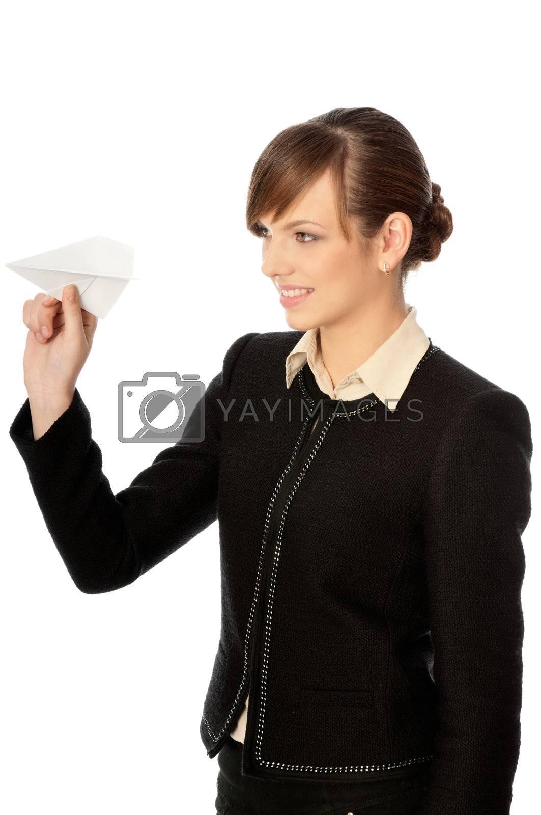Businesswoman throwing white paper plane on the break