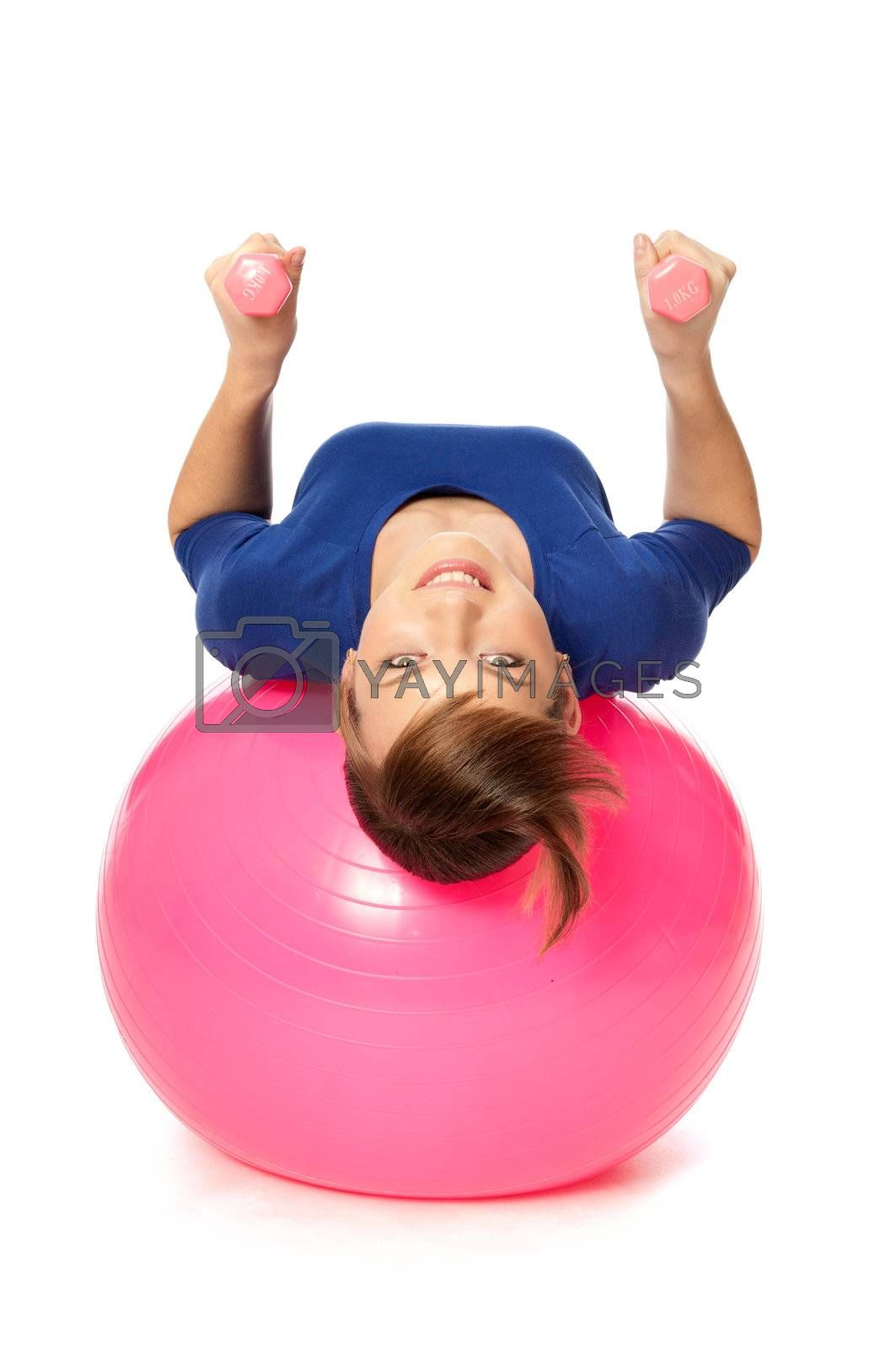 instructor showing exercises using ball and dumbbells at gym to people