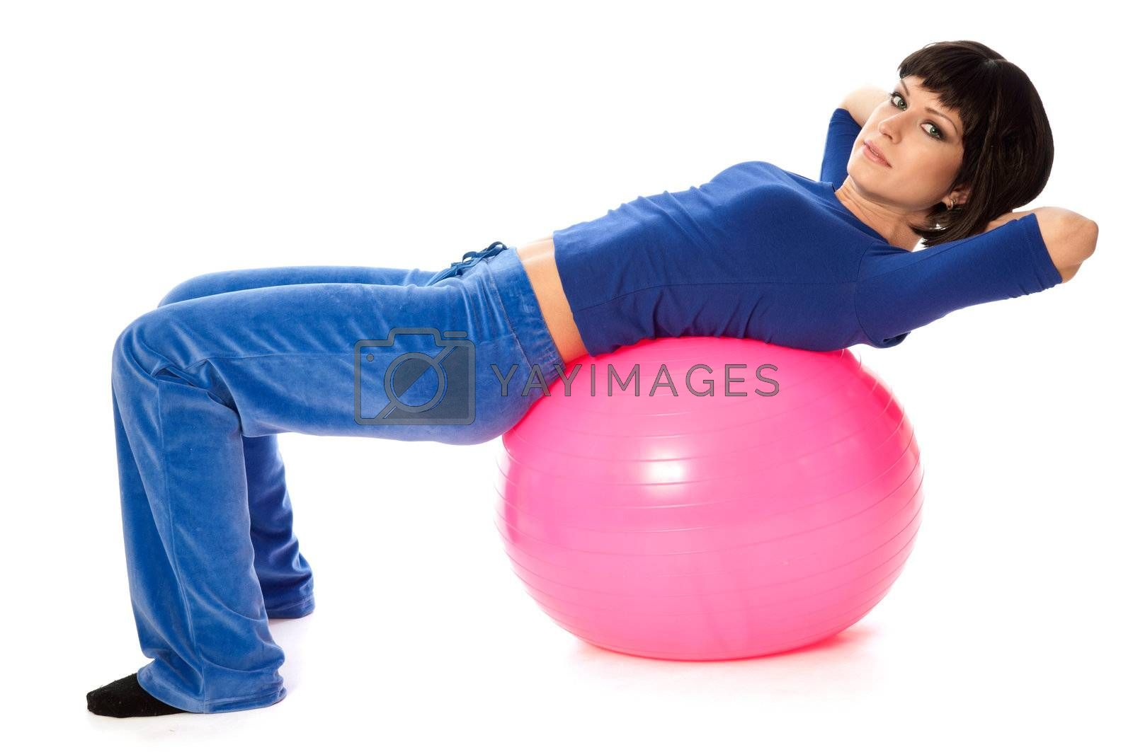 instructor showing exercises using fitball at gym to people