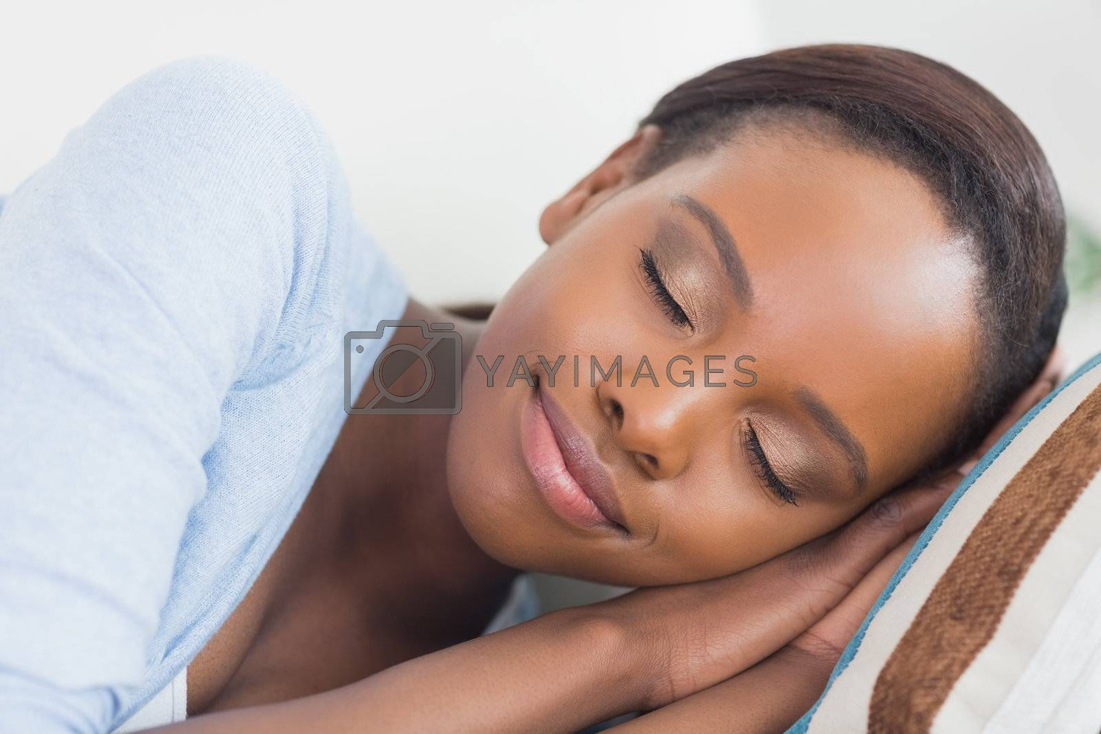 Black woman with closed eyes in a living room
