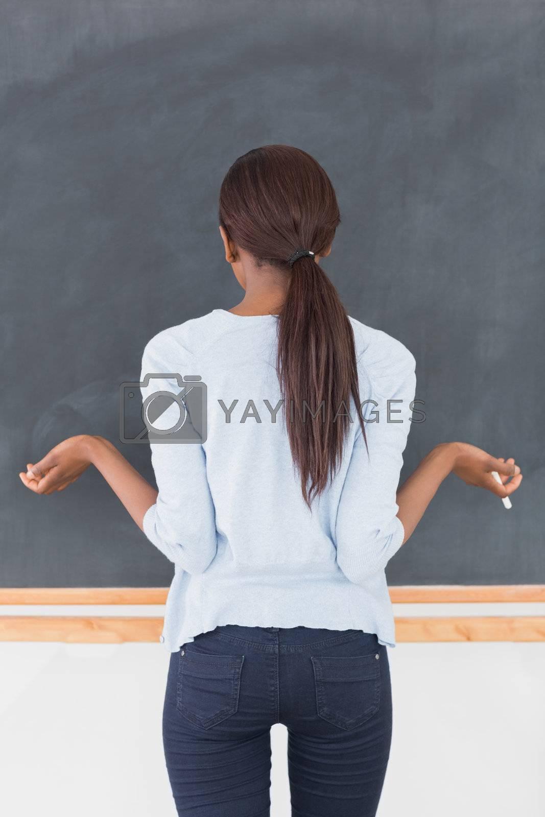 Black woman seeming uncertain in a classroom