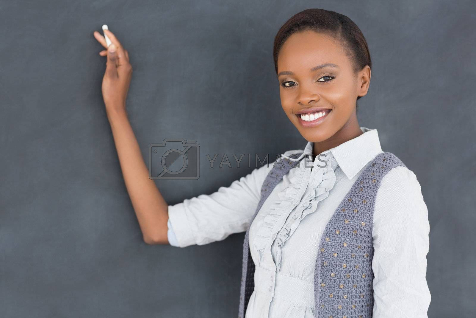 Black teacher looking at camera in a classroom