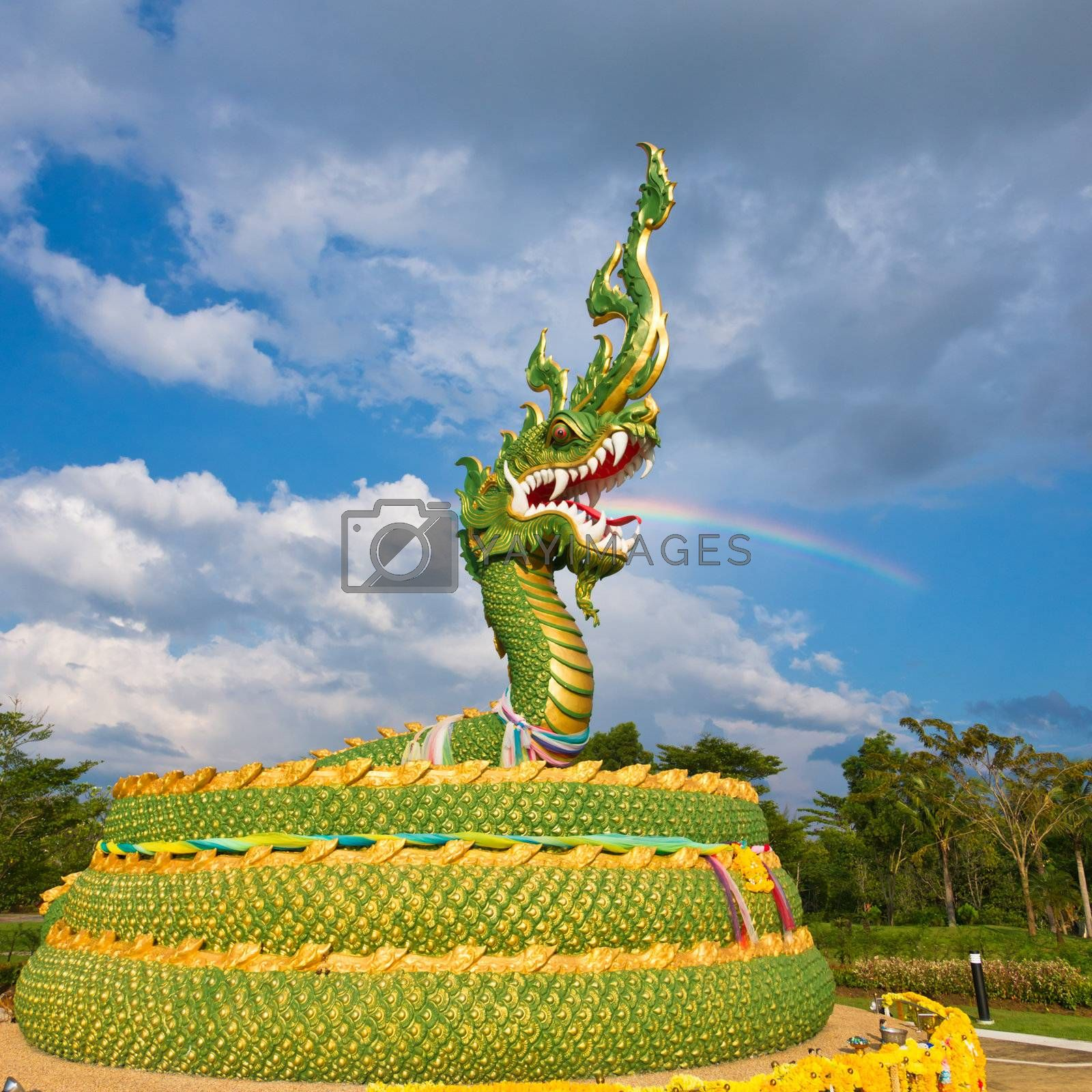The statue of asian dragon on the cloudy sky background