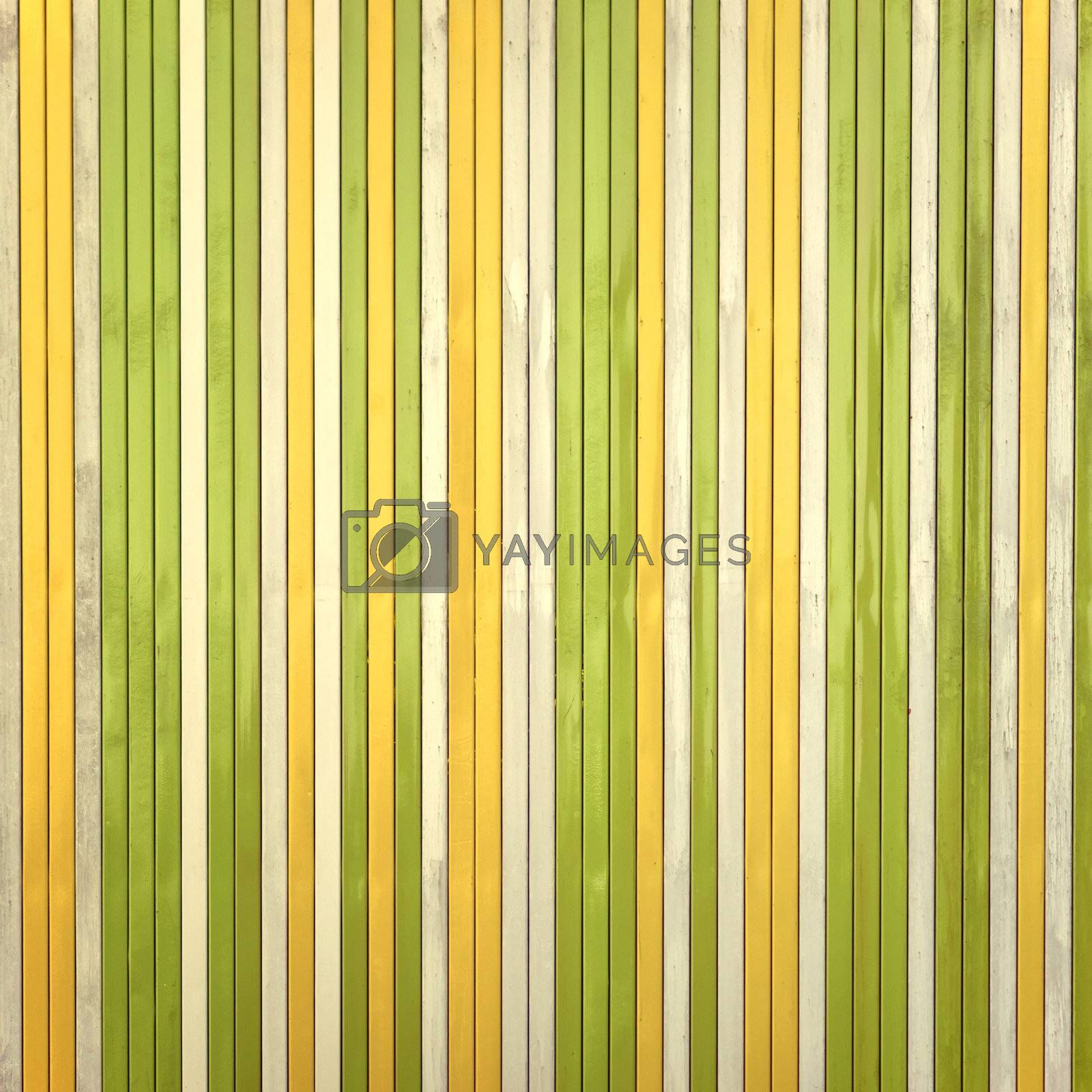 Real striped fence with nice random colours. Beautiful background with natural palette.