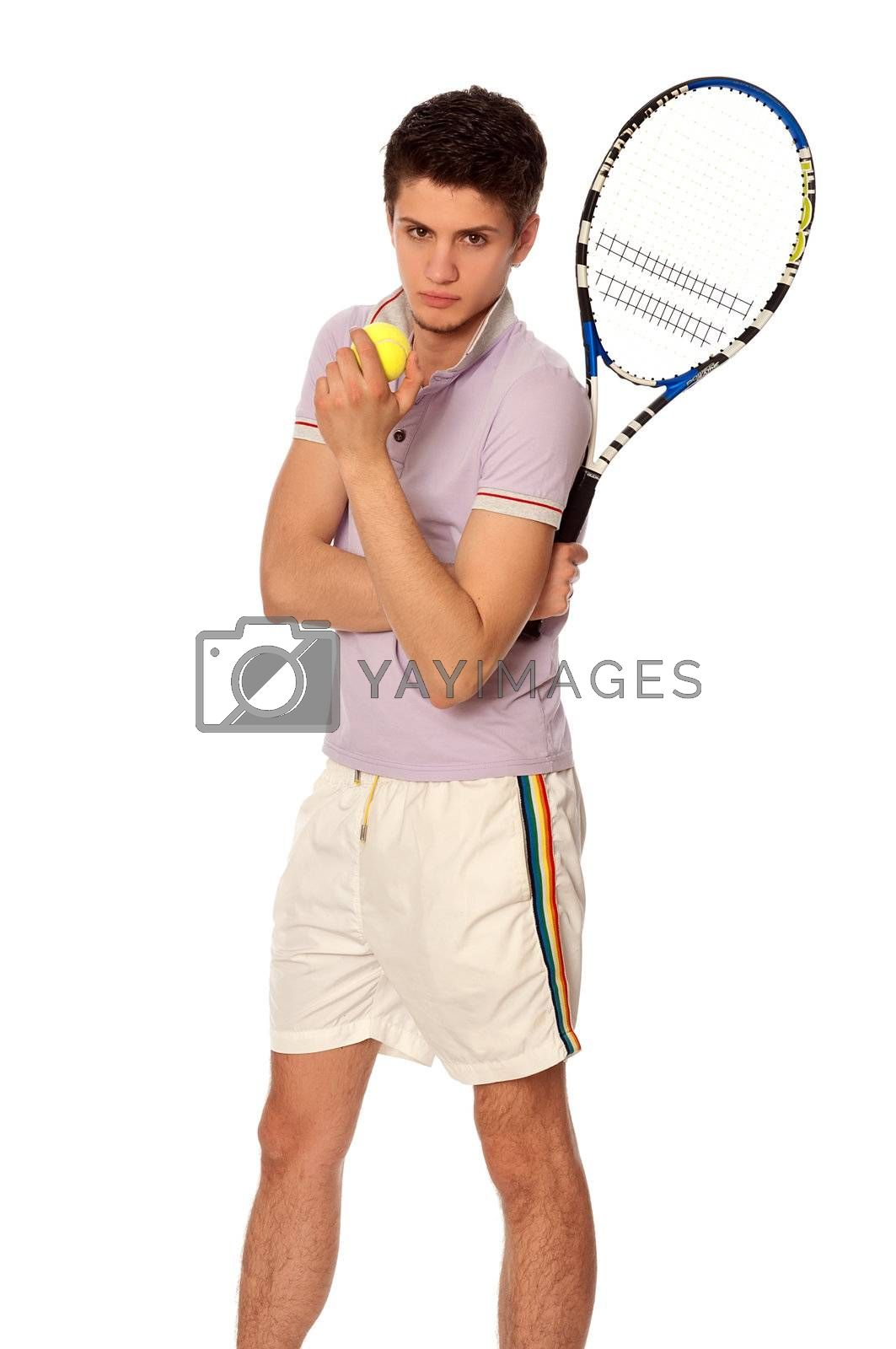 man with racket concentrated on playing tennis and preparing for the ball serving