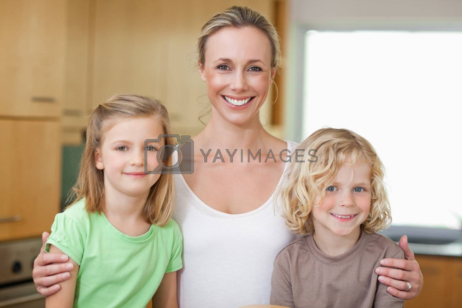 Mother with daughter and son in the kitchen by Wavebreakmedia