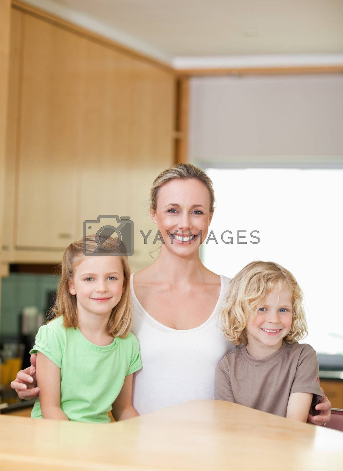 Mother with daughter and son in the kitchen together by Wavebreakmedia