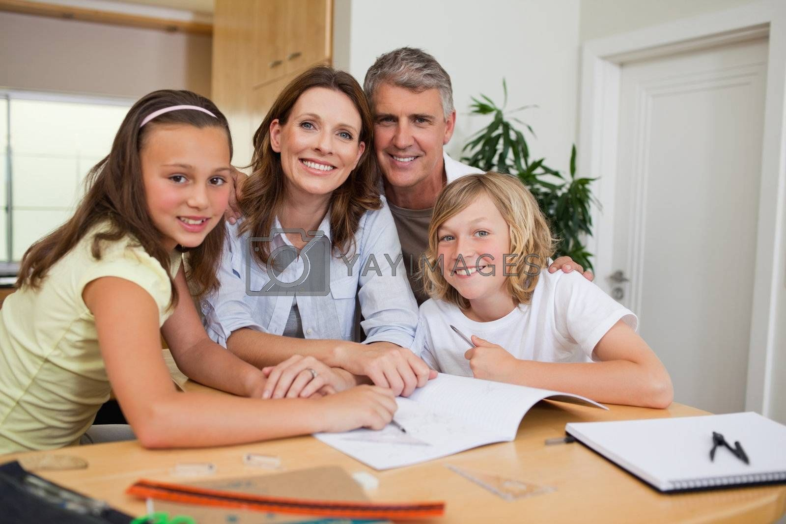 Family doing homework by Wavebreakmedia