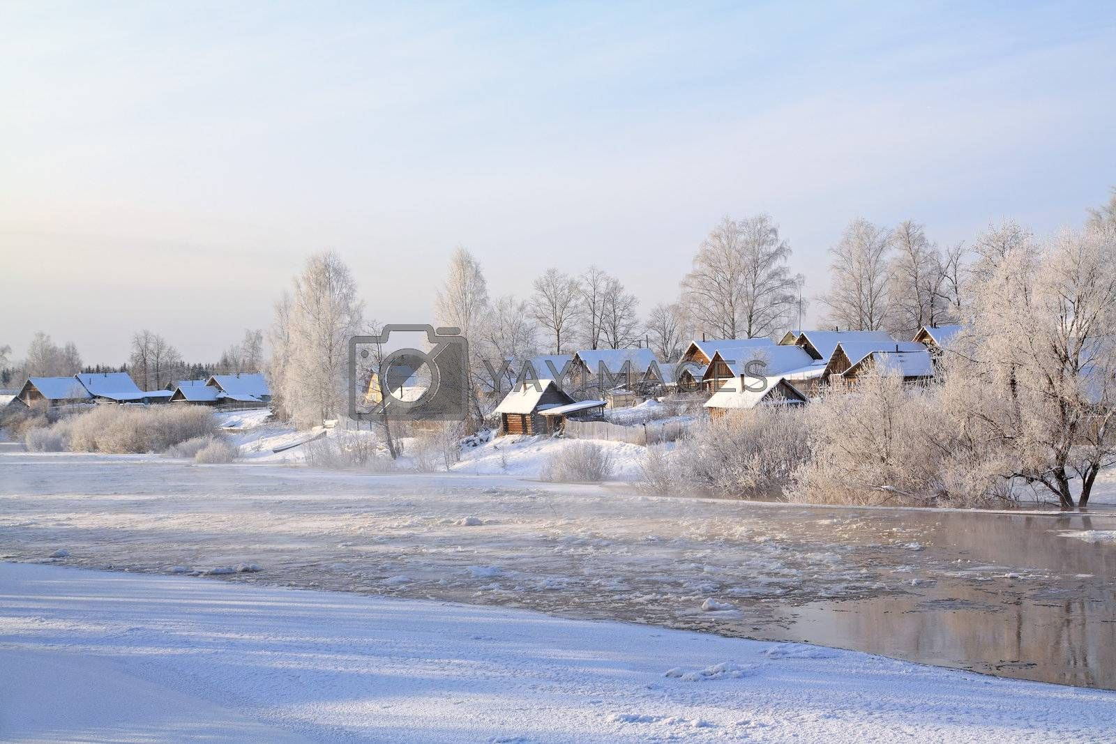 winter ice on river near villages