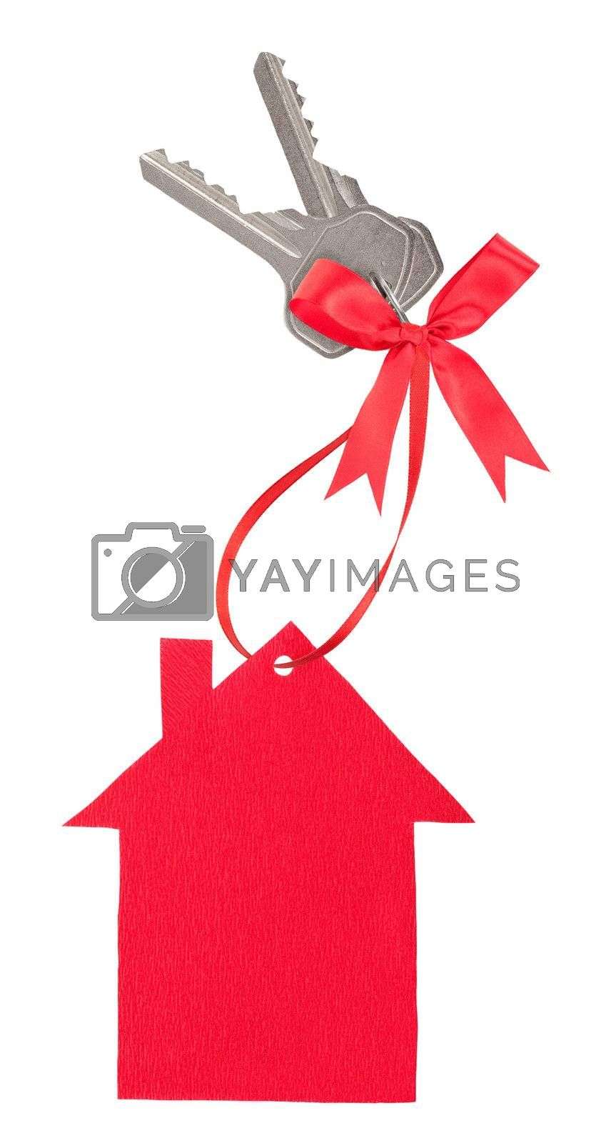 Red paper house with keys and a bow