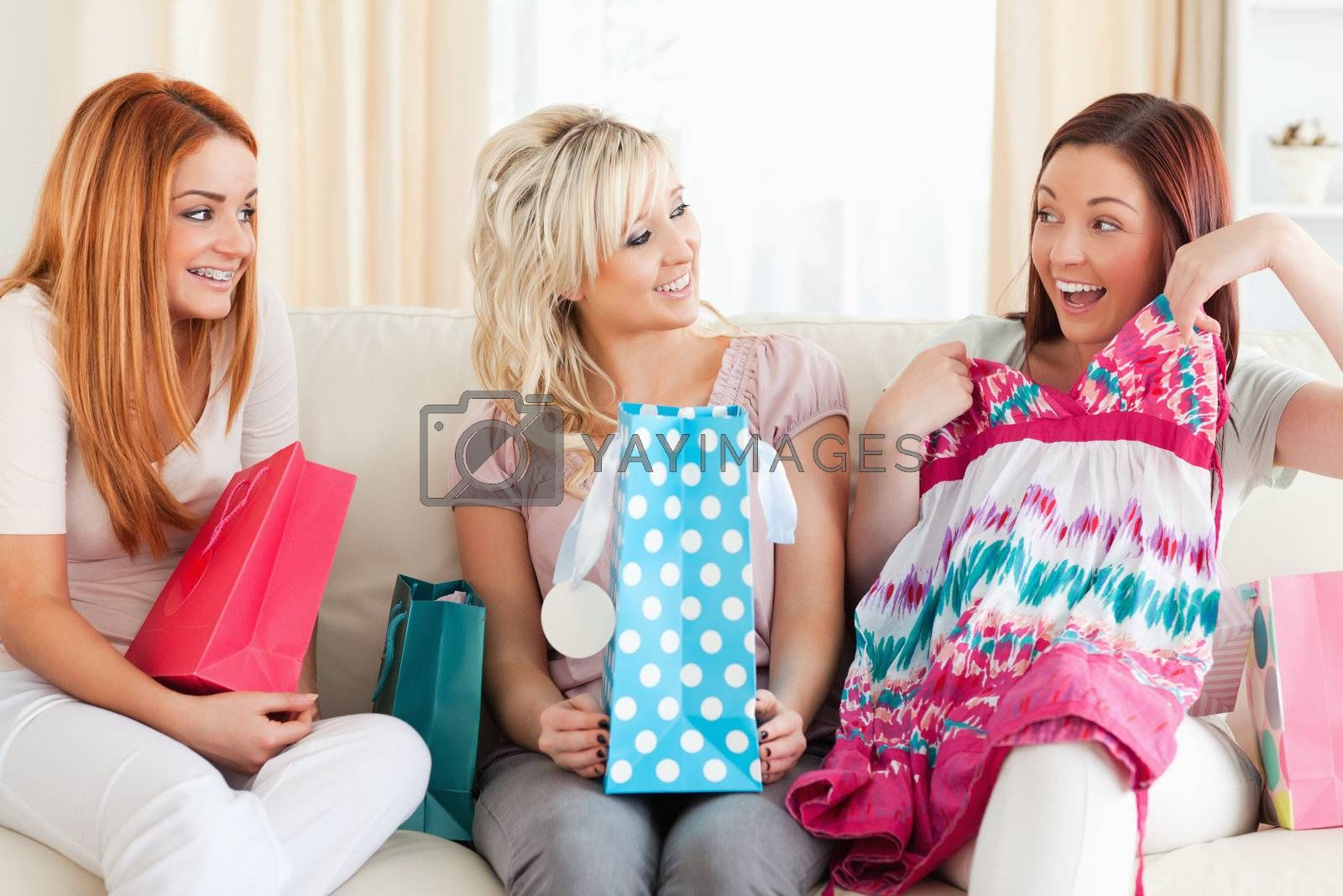 Cute Women with shopping bags in a living room