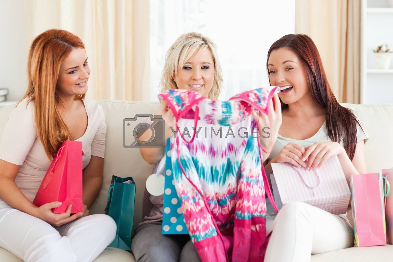 Women with shopping bags in a living room