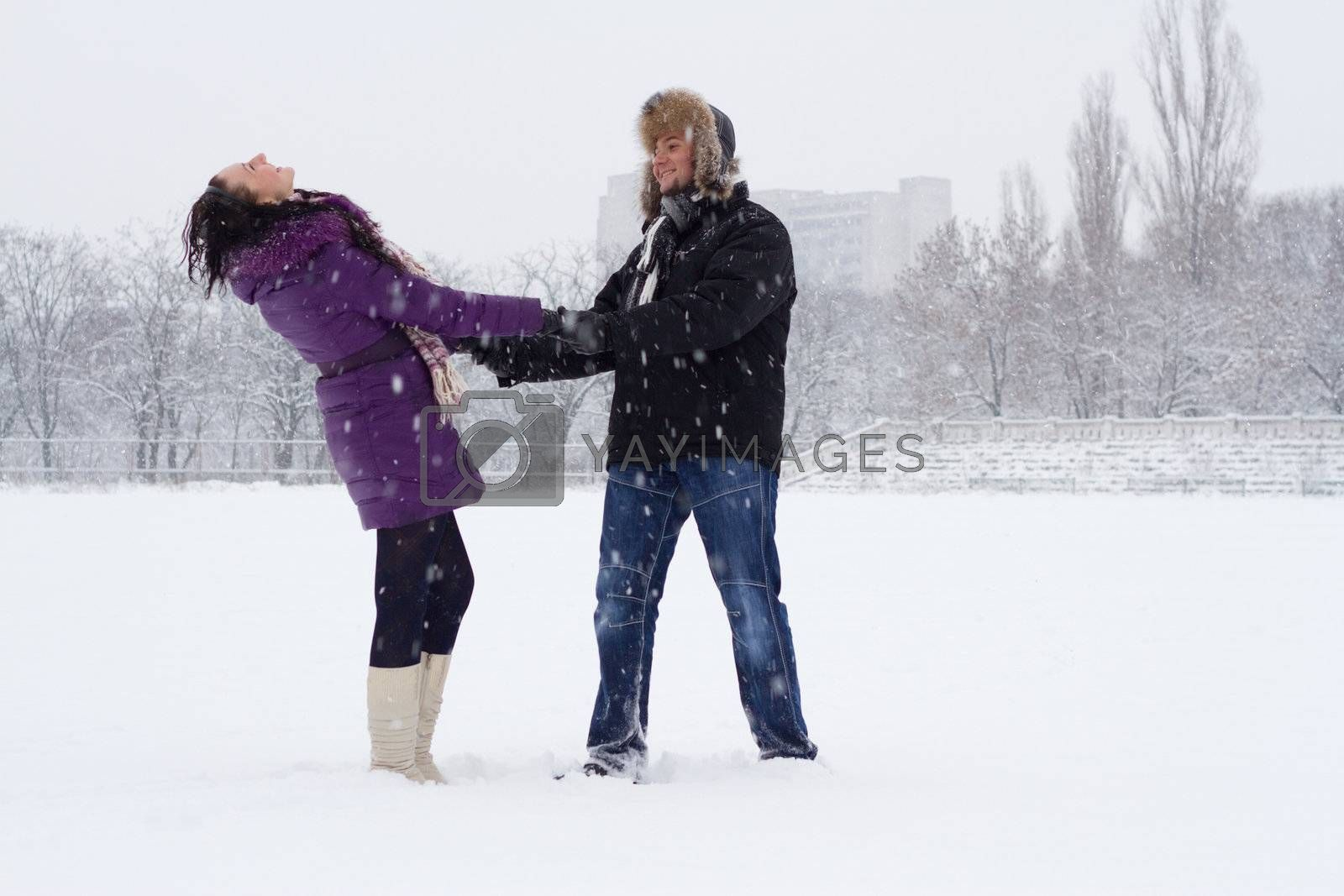 Young romantic couple in winter park