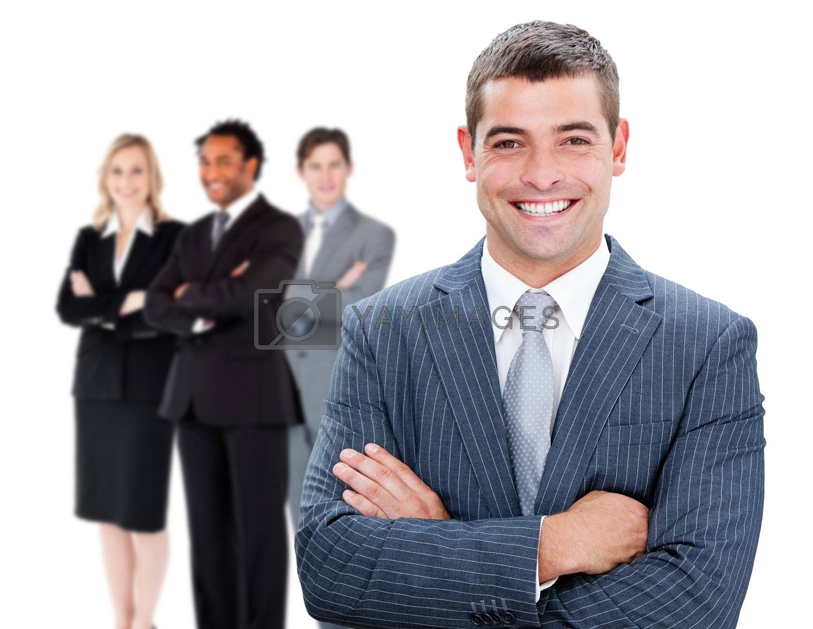 Businessman in front of colleagues against white background