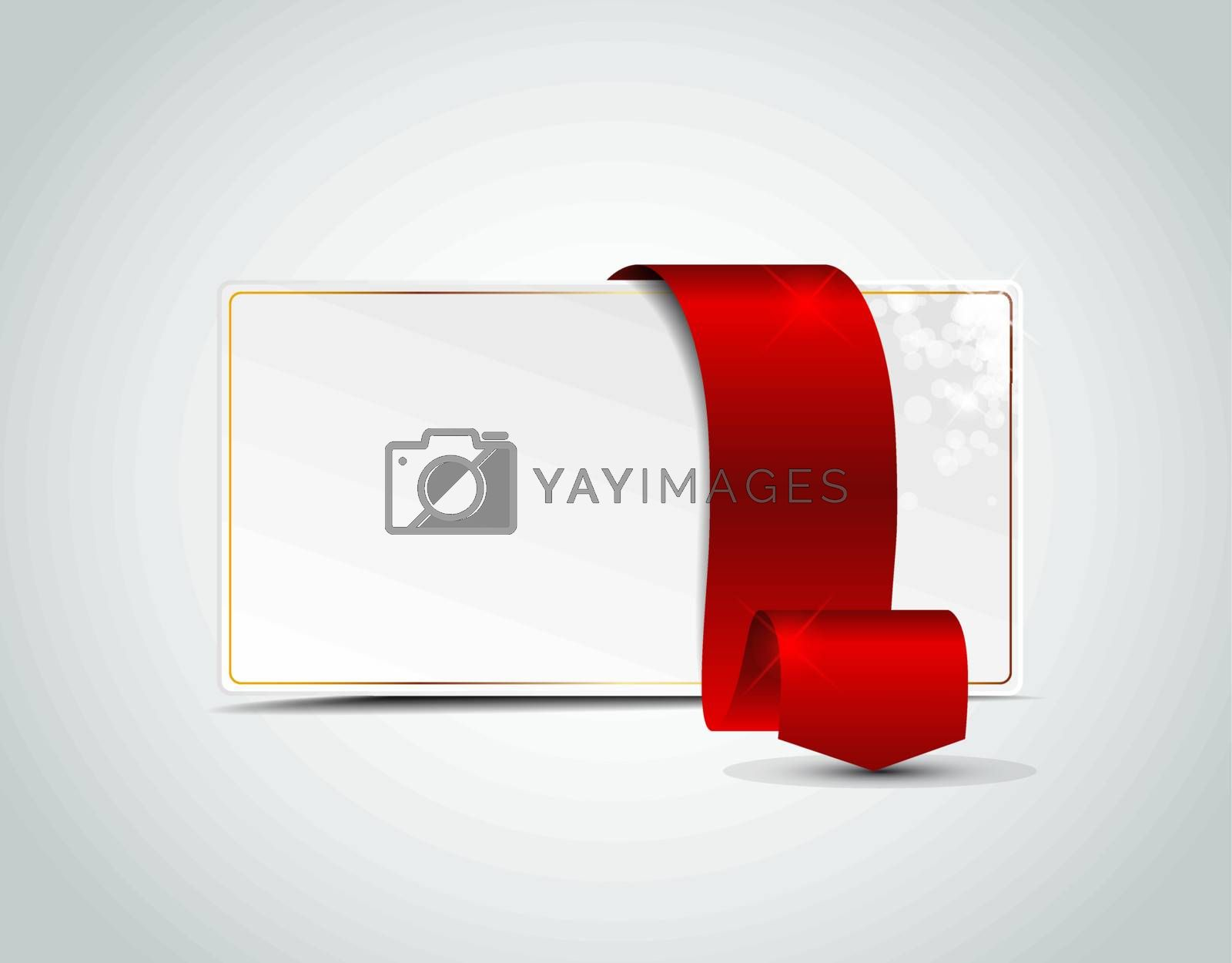 card with red ribbon on white paper
