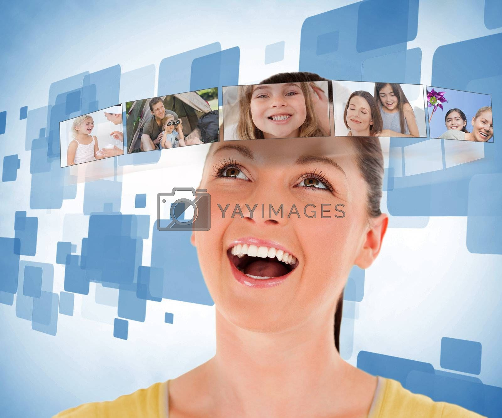 Smiling woman looking at picture bar on blue background