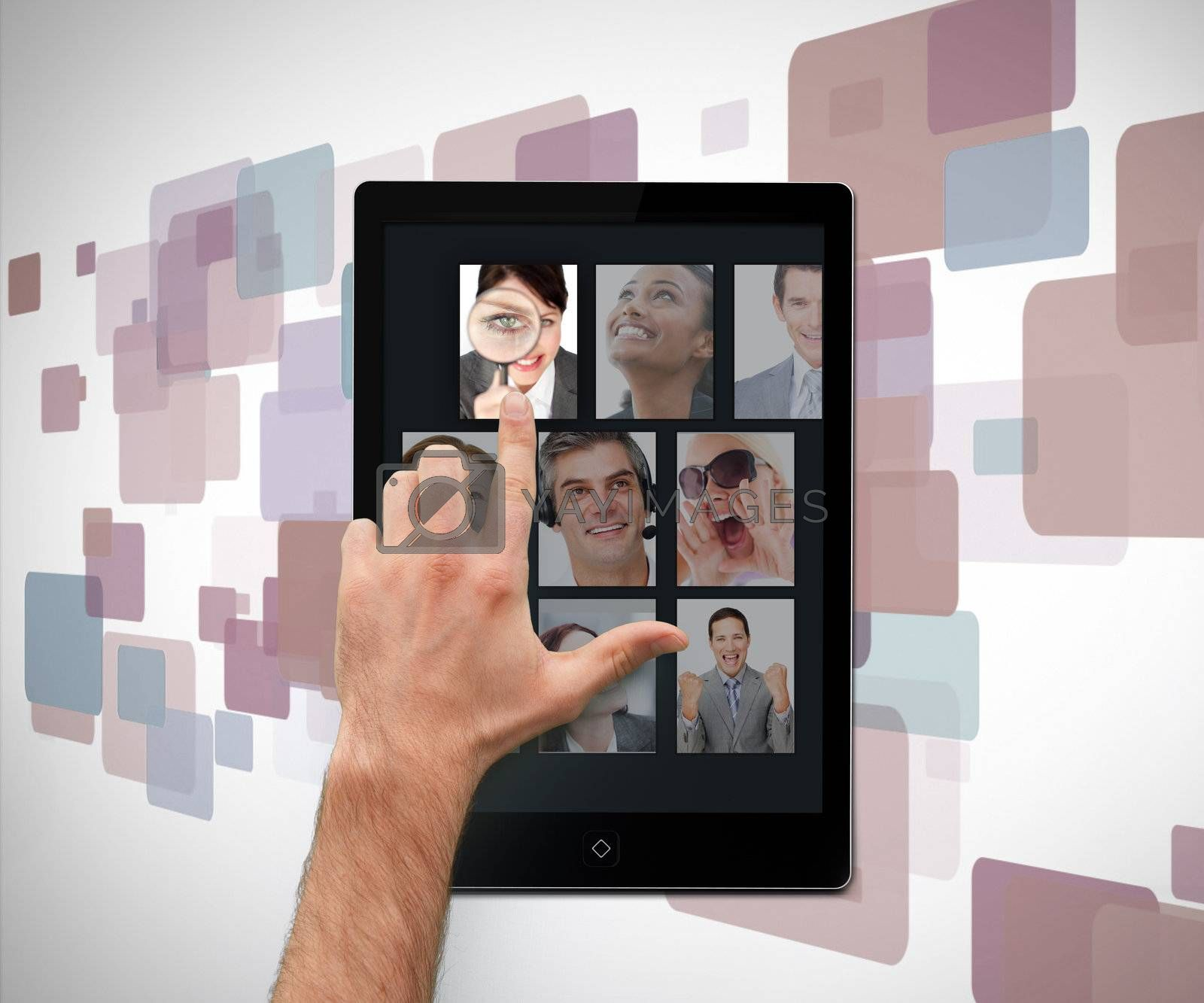 Hand pointing on tablet pc showing photos on digital background