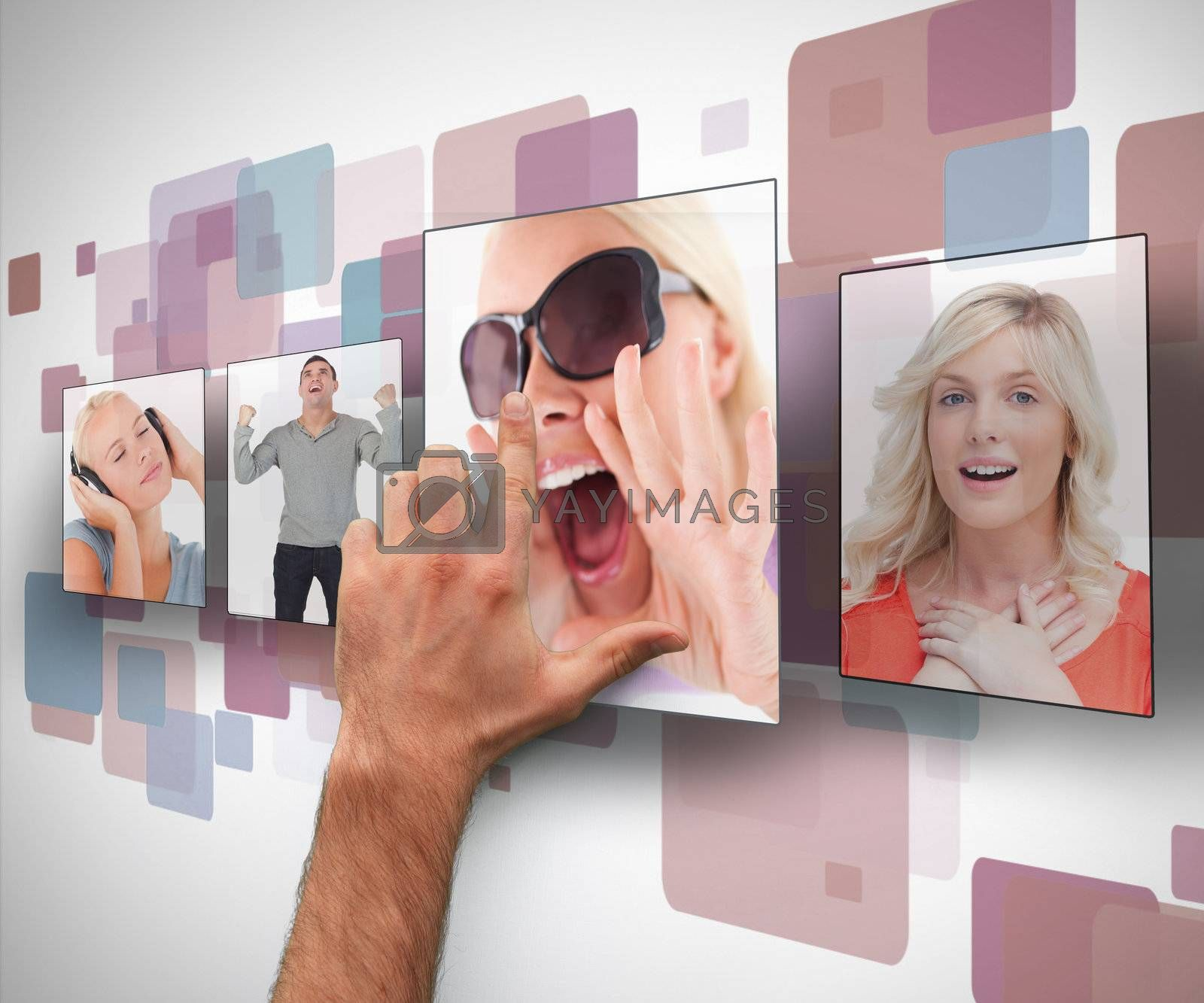 Male hand selecting photo from digital blue purple and white wall