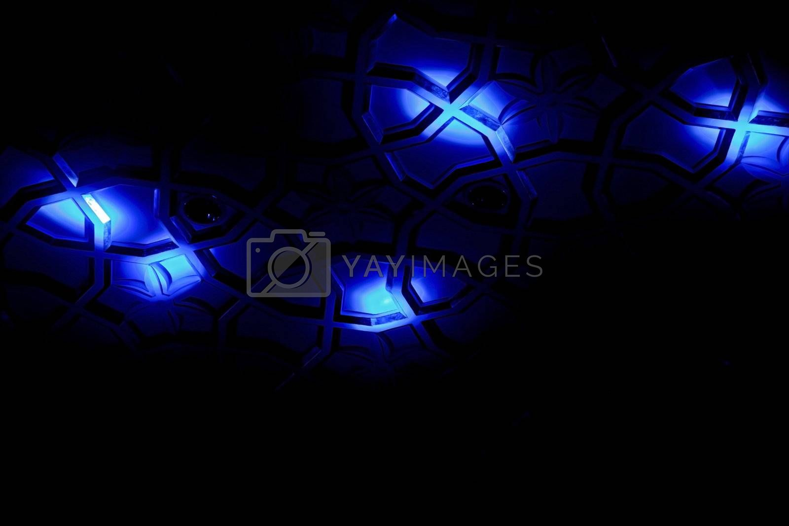 Generic shot of blue spot lights falling on a patterned surface creating shapes, angles, lines and form. Shot location was Goa India