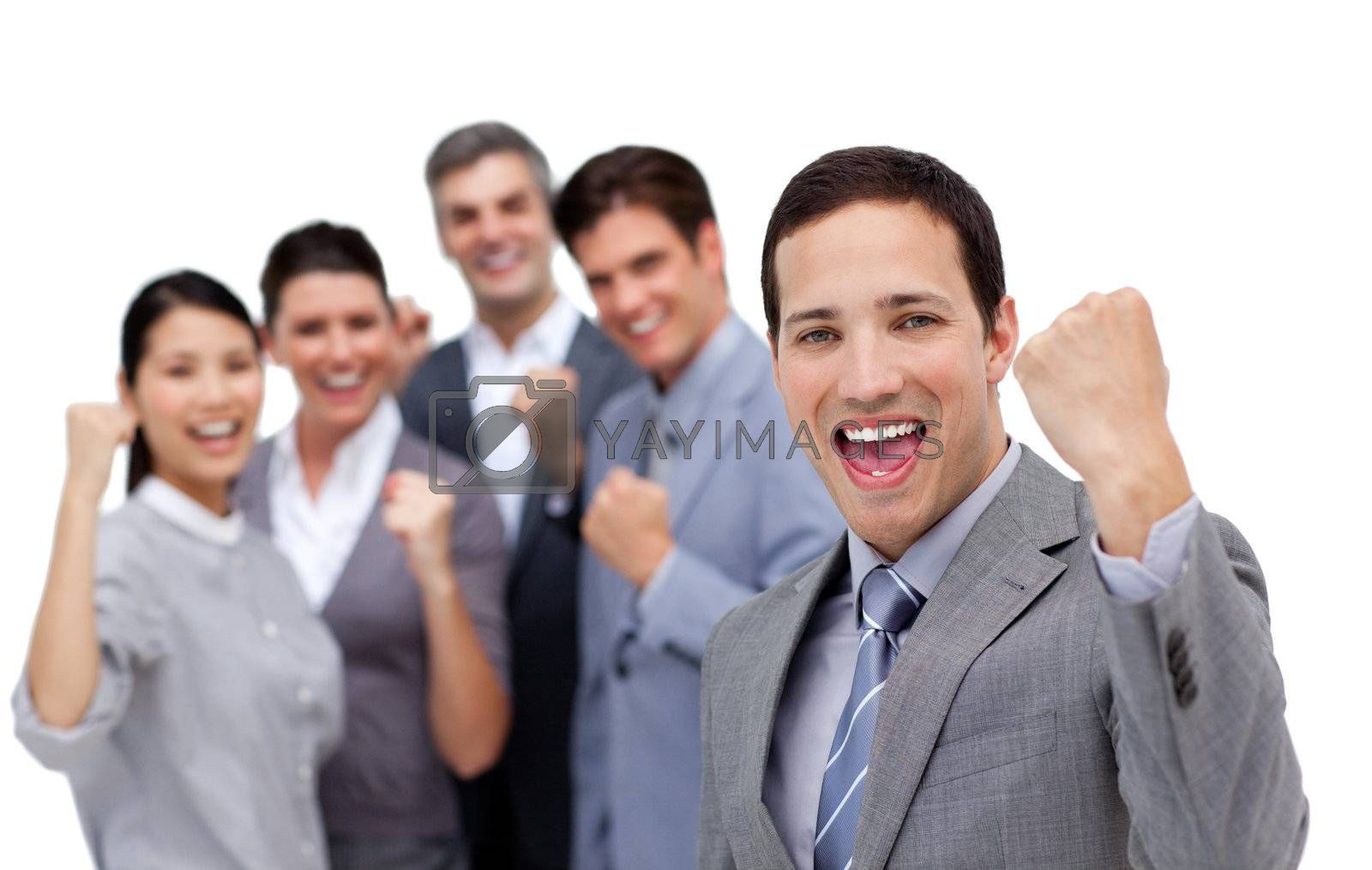 Successful business team punching the air in celebration by Wavebreakmedia