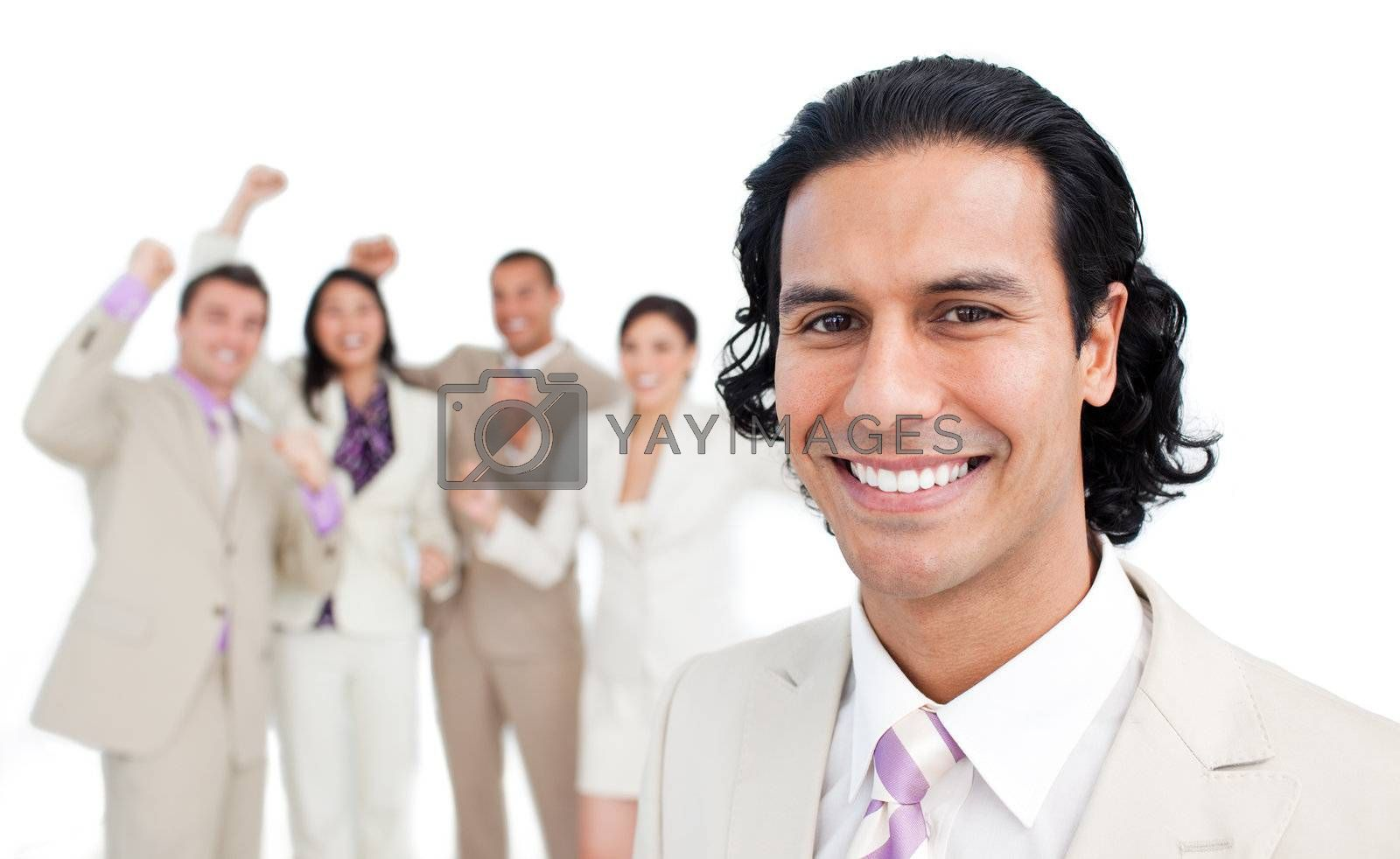 Successful business team punching the air in celebration against a white background