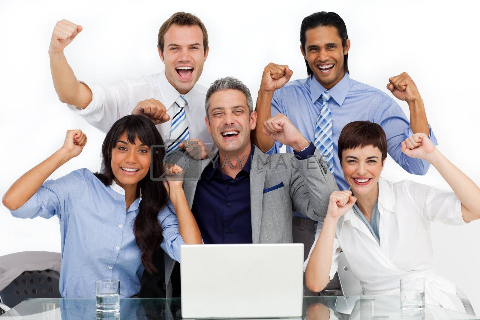 Fortunate business team punching the air in celebration in the office